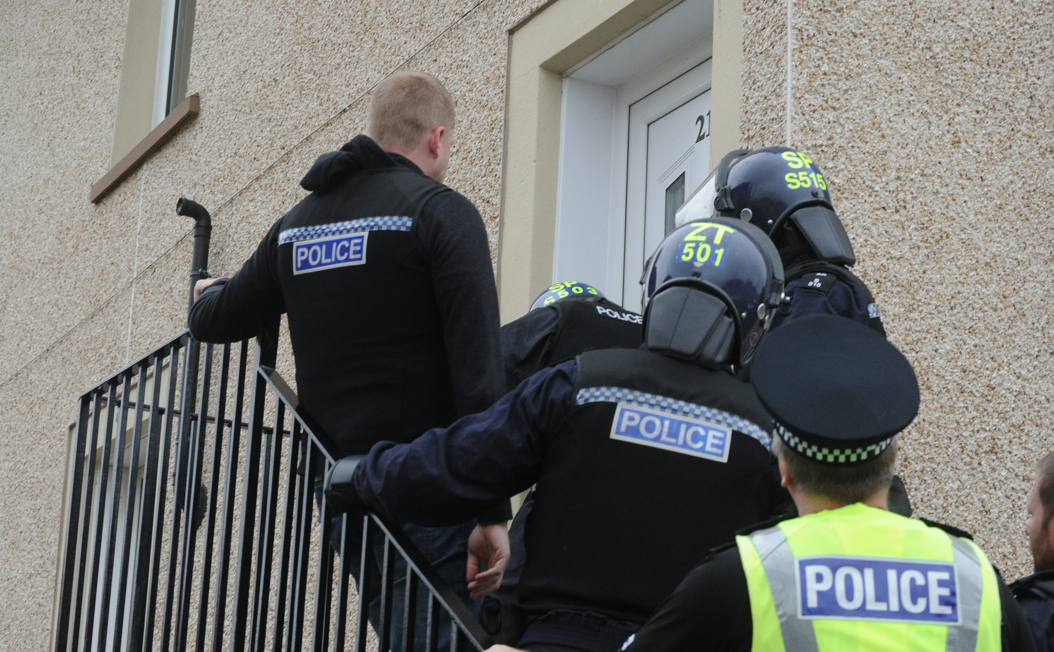 Police as they 'hit' four properties in relation to various crimes reported to them.