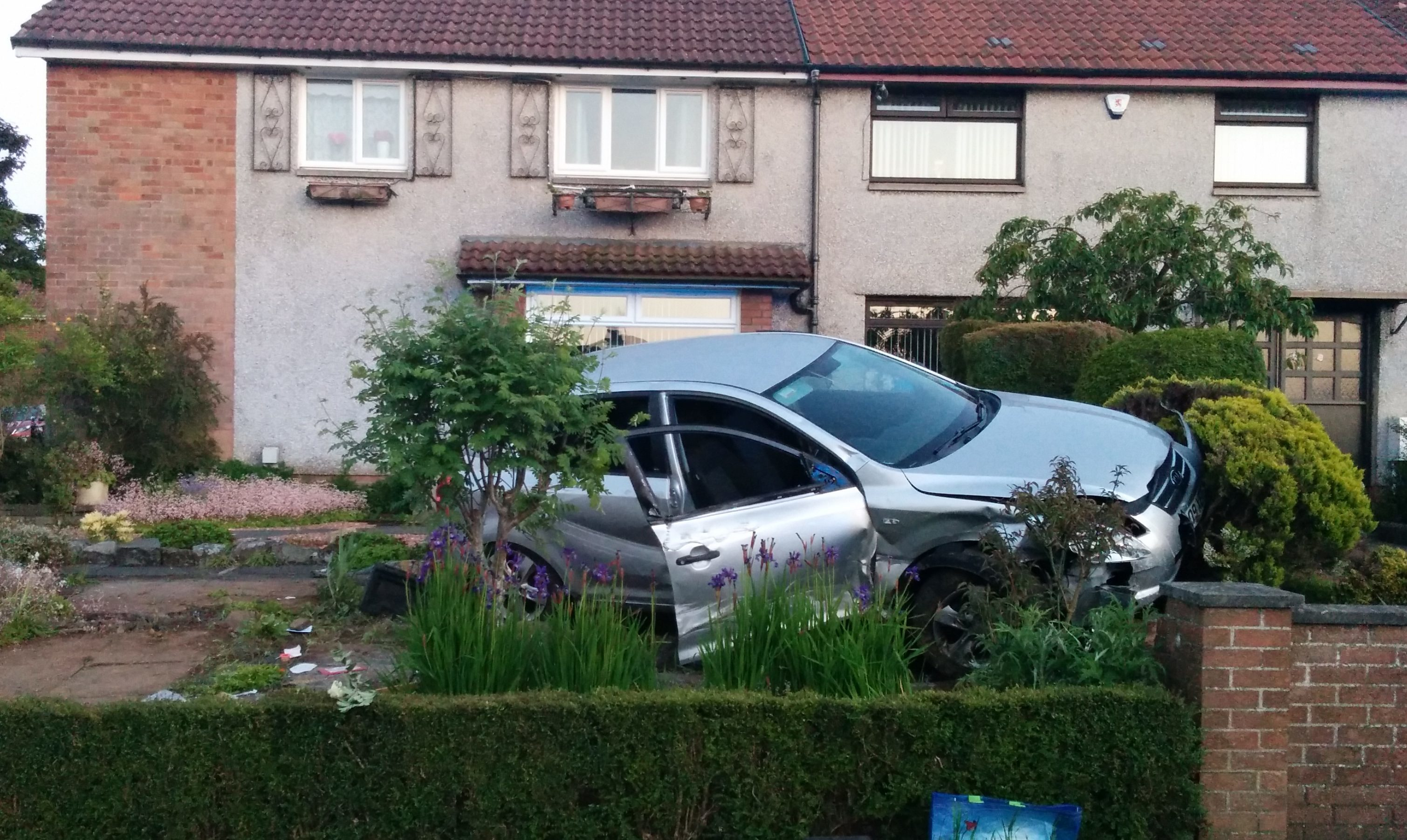 The car driven by Gordon Suttie overturned and crashed into a garden.