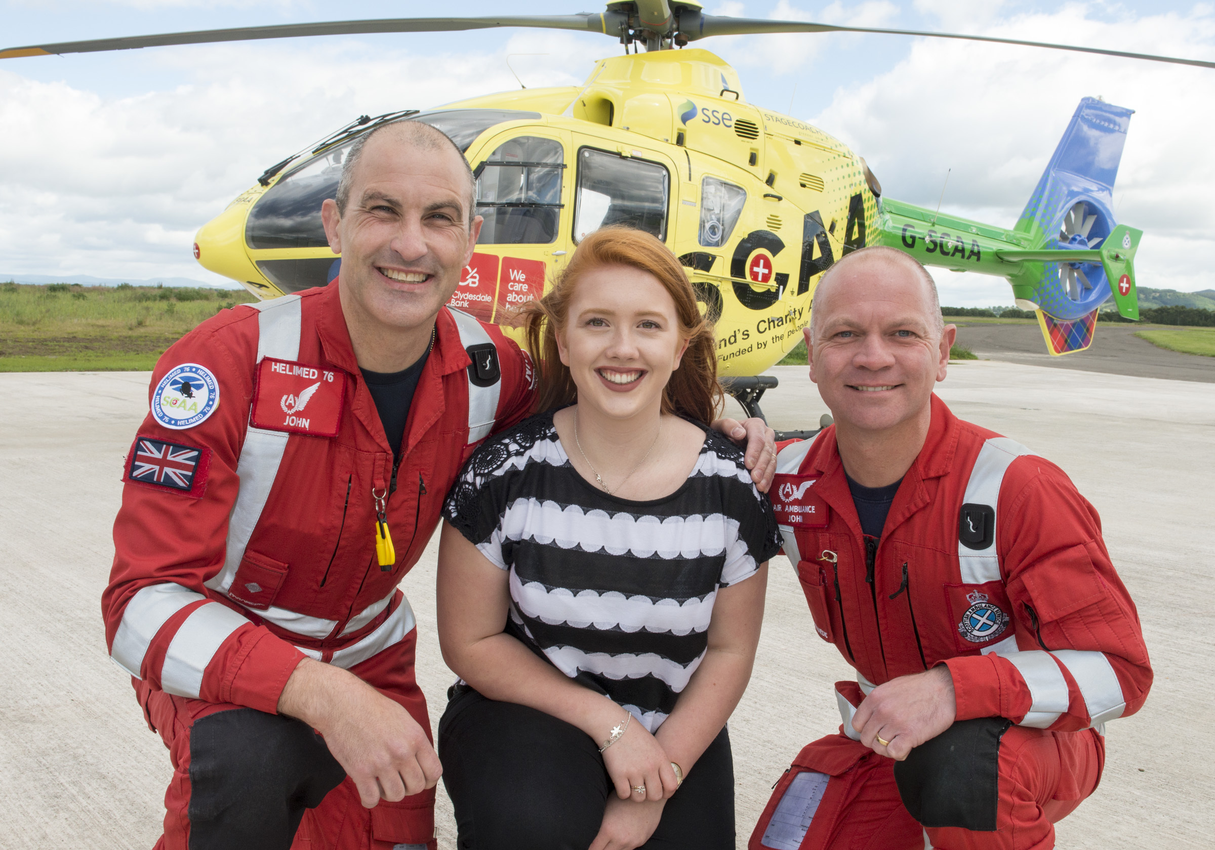 Lucy Smith with paramedics John Pritchard and John Salmond.