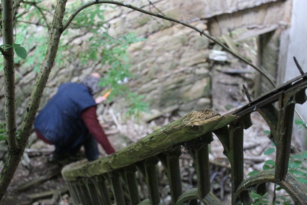 Jag Betty climbs down the rickety spiral staircase at Crawford Priory.