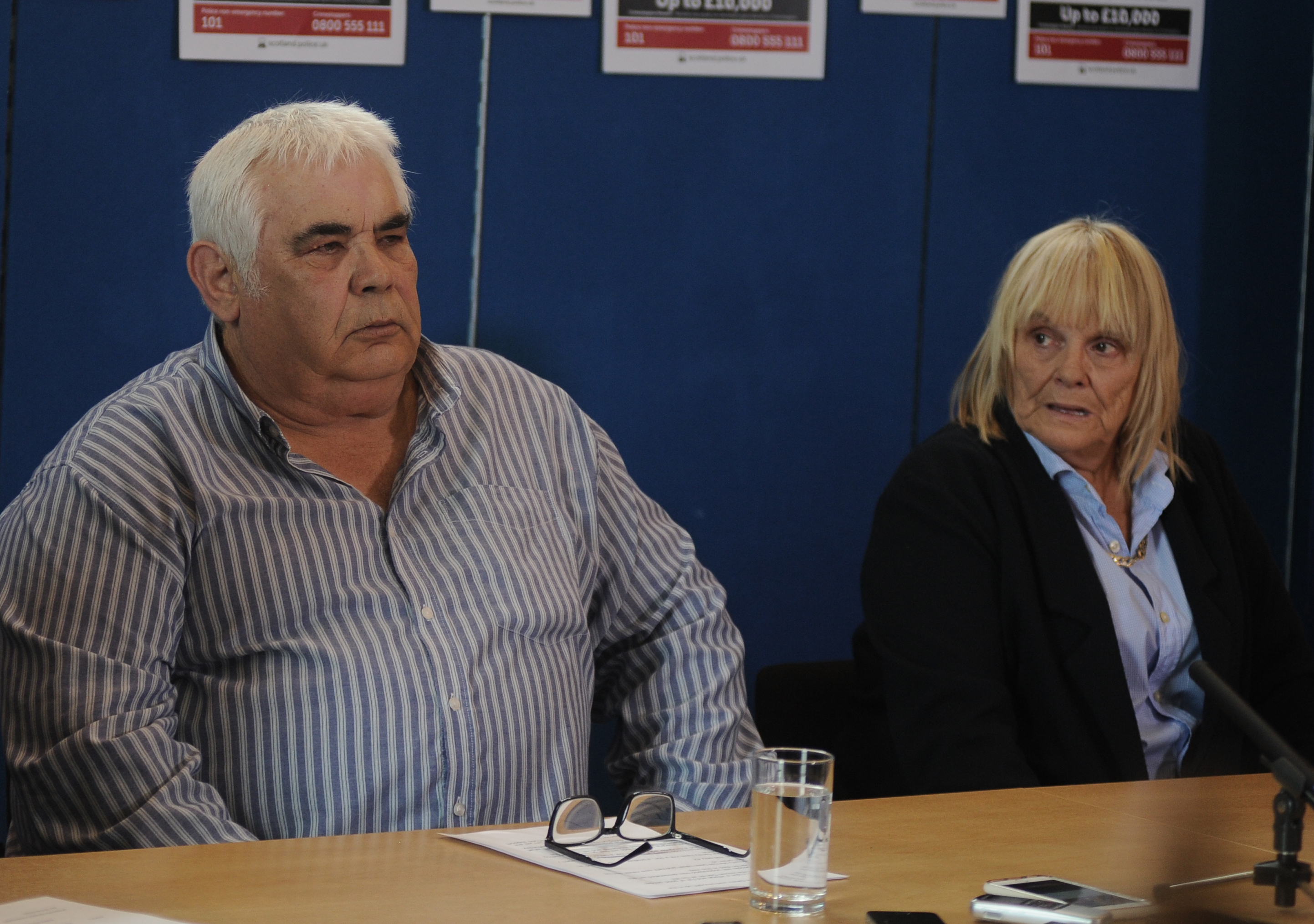 Darren Adie's parents John and Margaret addressing a press conference.