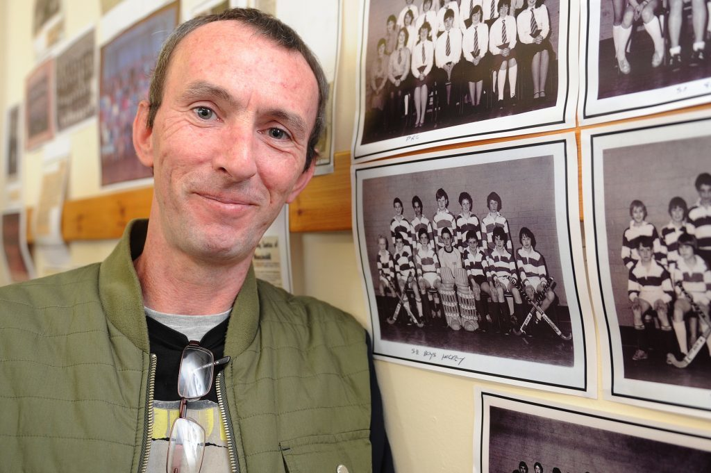 David McCabe with the picture of the S2 boy's hockey team that toured in Germany in 1982 that he was part of.