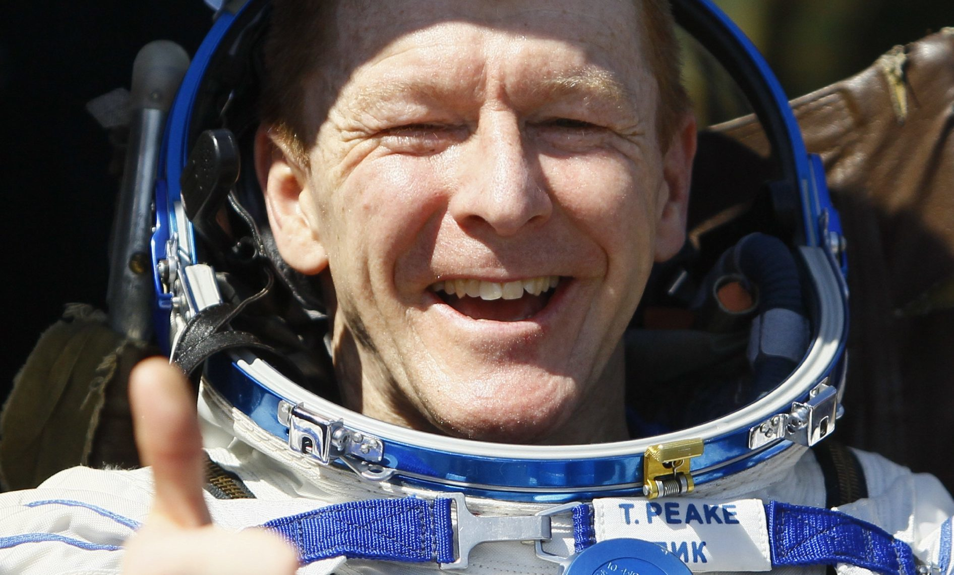 Tim Peake gives a thumbs-up shortly after landing.