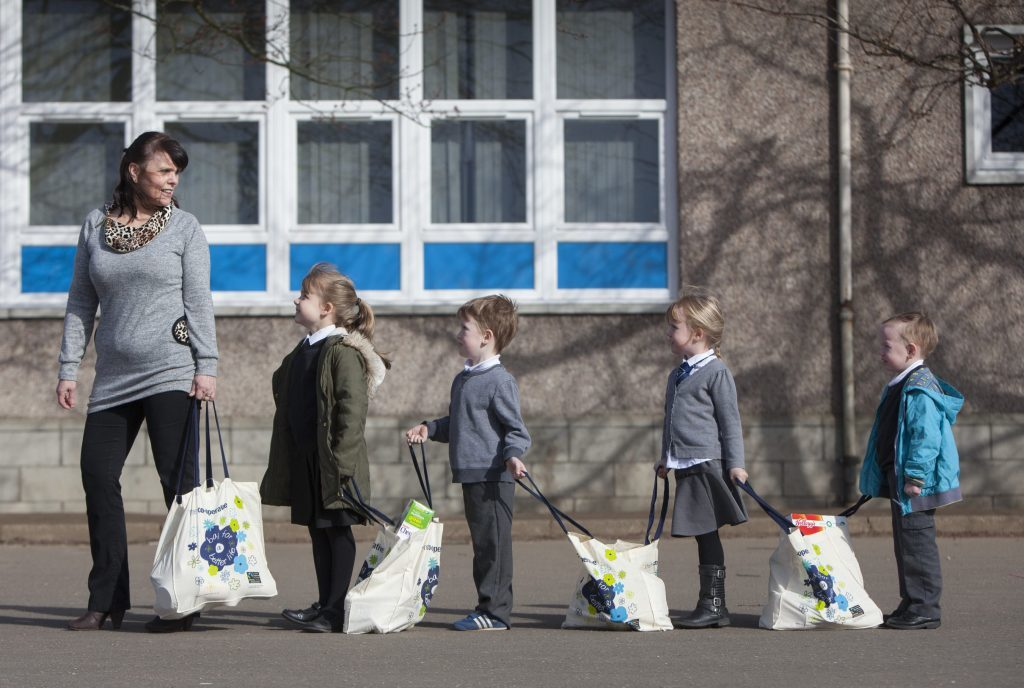 Last year, FareShare joined with RBS and Dundee's Longhaugh Primary School to launch a new food waste initiative, where parents of pupils are invited on a weekly basis to visit the school and take away free shopping parcels. Picture shows Teacher Anne McKinney and pupils Katie-Leigh Buchanan, Daniel Finlayson, Ellie Monks and Kallan Hansen.