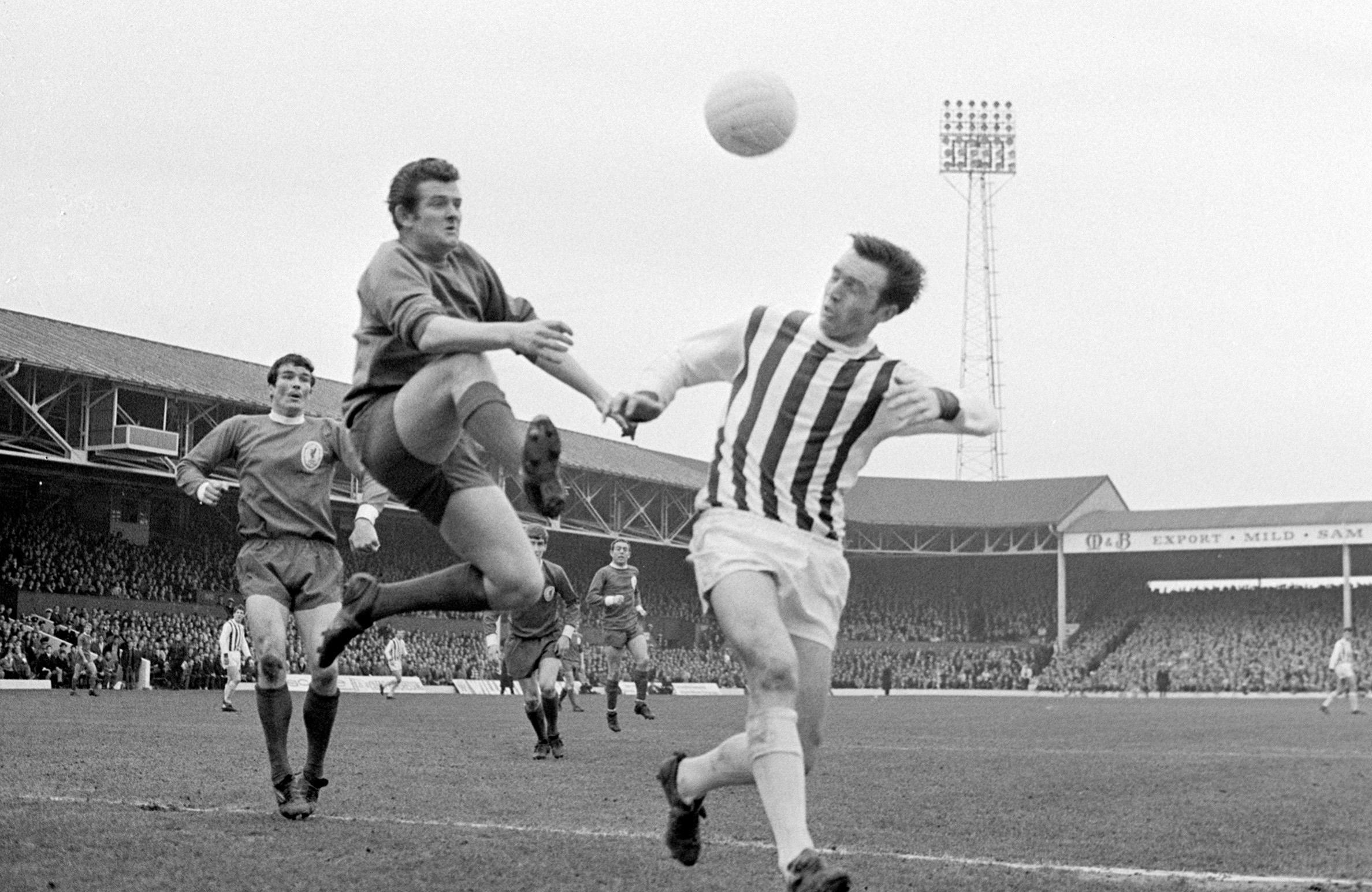 Jeff Astle in an aerial challenge with Tommy Lawrence, the former Liverpool goalkeeper.