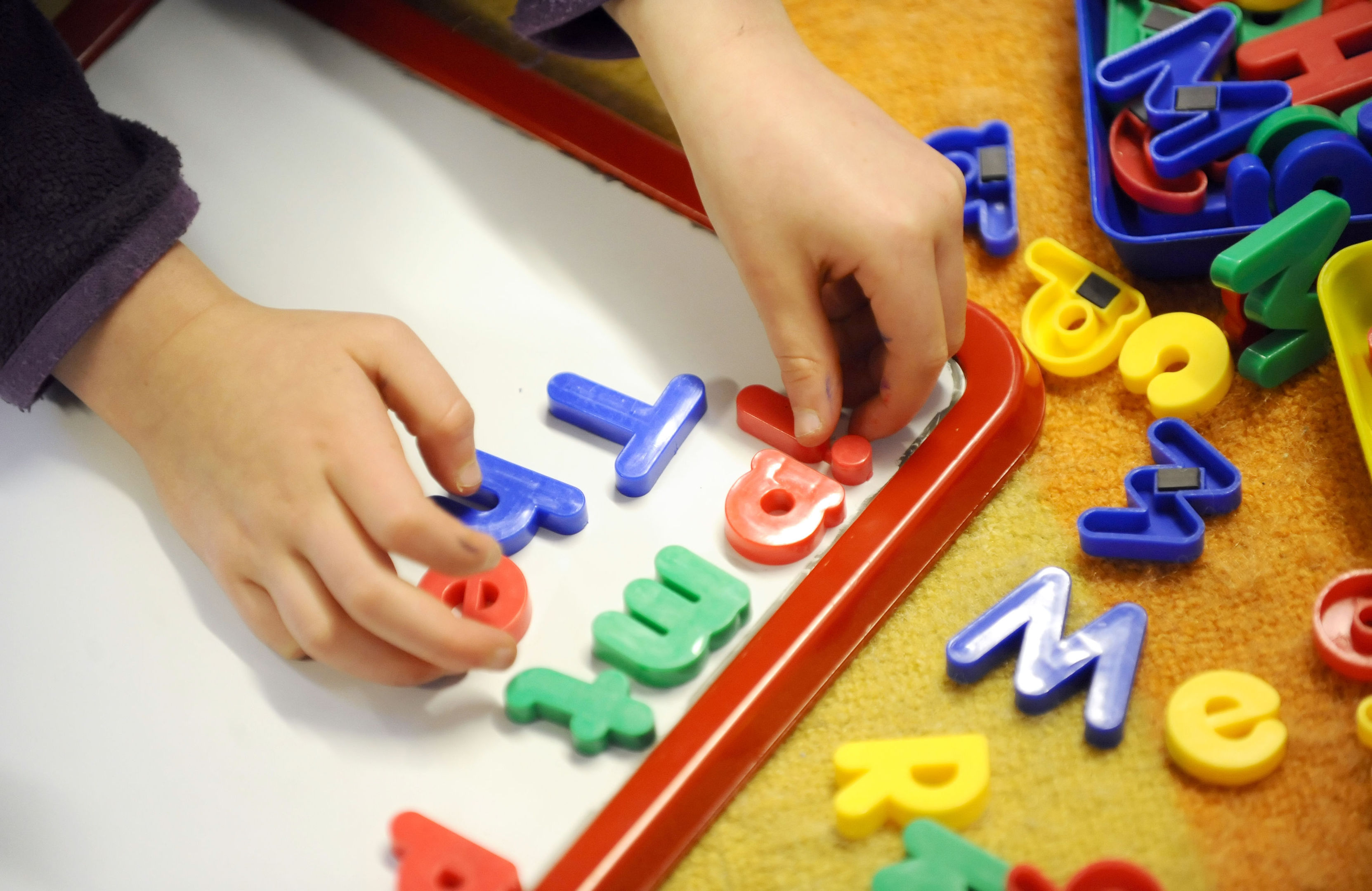 A regulator boss has accused the Scottish Government of undervaluing the childcare profession.