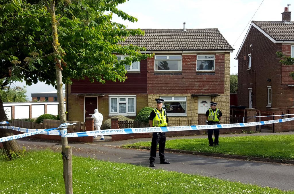 Police guard the house in Lowood Lane where Tommy Mair, the suspect arrested over the shooting of Labour MP Jo Cox, lives in Birstall, West Yorkshire. PRESS ASSOCIATION Photo. Picture date: Thursday June 16, 2016. See PA story POLICE MP. Photo credit should read: Dave Higgens/PA Wire