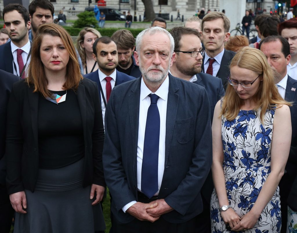 """Labour Party leader Jeremy Corbyn (centre) stands during an impromptu vigil at Parliament Square opposite the Palace of Westminster, central London, following the death of Labour MP Jo Cox, who died after being shot and stabbed in the street outside her constituency advice surgery in Birstall, West Yorkshire. PRESS ASSOCIATION Photo. Picture date: Thursday June 16, 2016. The alleged gunman has been named locally as Tommy Mair, 52, who neighbours in Birstall have described as """"a loner"""". See PA story POLICE MP. Photo credit should read: Philip Toscano/PA Wire"""