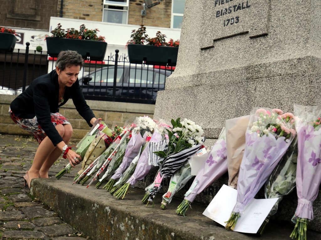 MP Mary Creagh lays flowers in Birstall, West Yorkshire, following the death of Labour MP Jo Cox, who died after being shot and stabbed in the street outside her constituency advice surgery in the town. PRESS ASSOCIATION Photo. Picture date: Thursday June 16, 2016. See PA story POLICE MP. Photo credit should read: Nigel Roddis/PA Wire