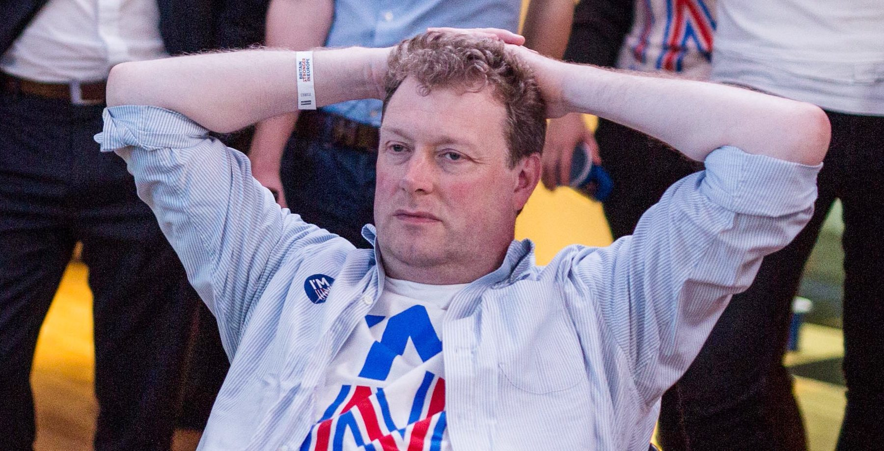 A dejected supporter of the Stronger In campaign reacts after hearing the results.