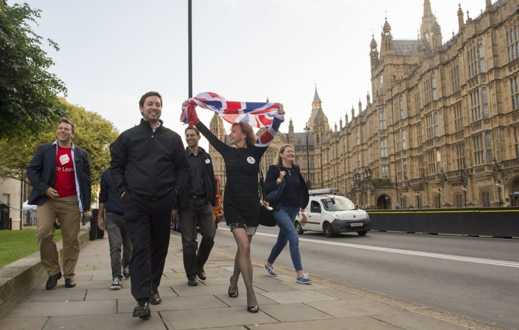 Leave supporters celebrate opposite the Houses of Parliament.