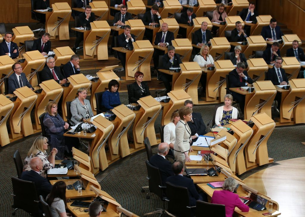 Scotland's First Minister Nicola Sturgeon making a statement on BREXIT to MSP's in the debating chamber at the Scottish Parliament in the Edinburgh. PRESS ASSOCIATION Photo. Picture date: Tuesday June 28, 2016. See PA story POLITICS EU Scotland. Photo credit should read: Andrew Milligan/PA Wire