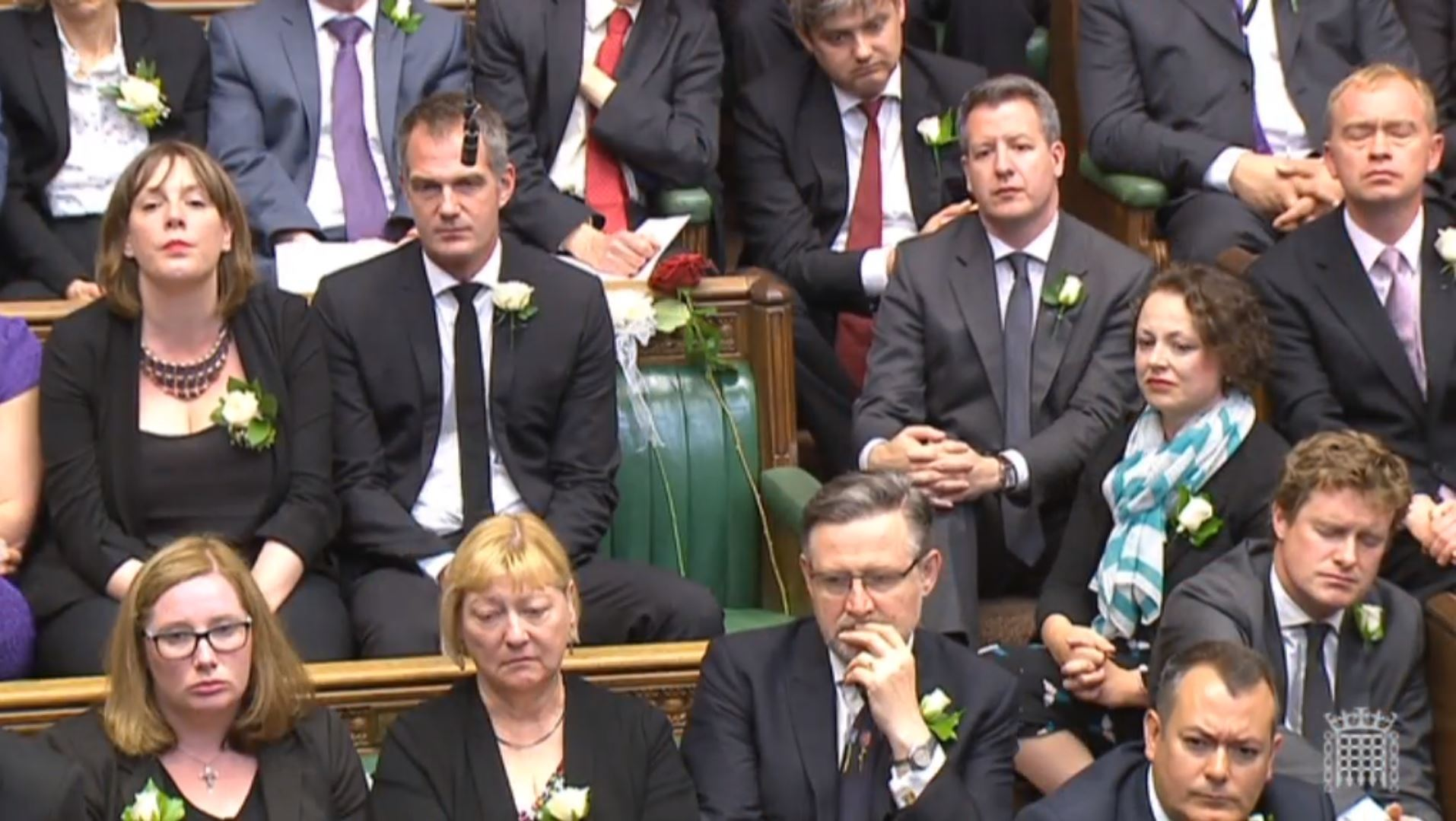A white and red rose lie on Jo Cox's empty seat in the House of Commons, London, as MPs gather to pay tribute to her.