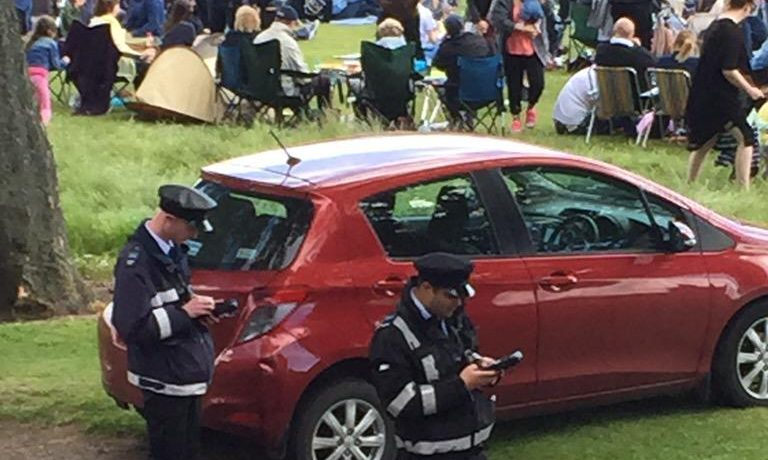Wardens ticketing cars at the 2015 festival. The problems appeared to have been resolved this year.