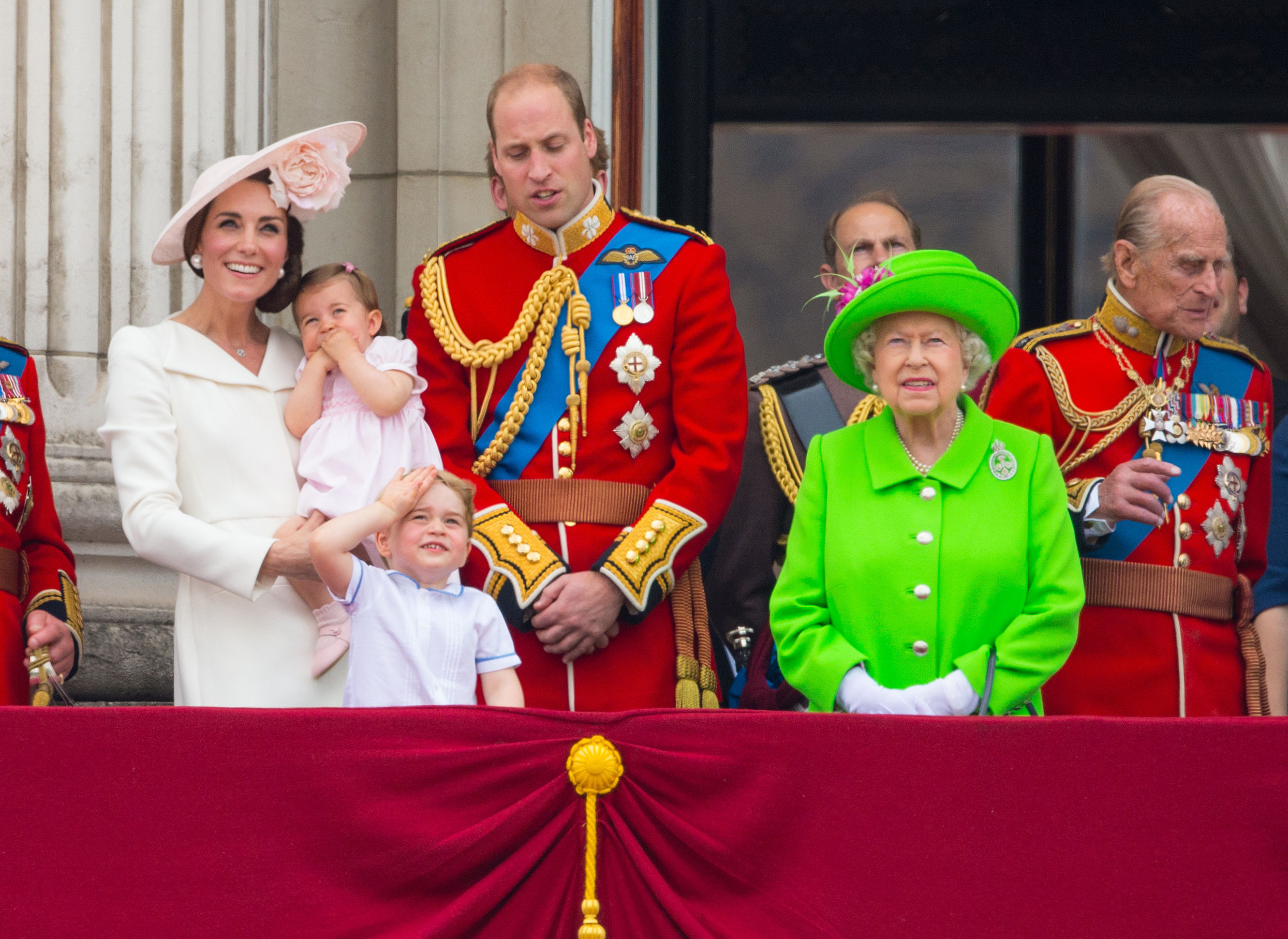 From left: The Duchess of Cambridge, Princess Charlotte, Prince George, the Duke of Cambridge, the Queen  and the Duke of Edinburgh watch a flypast from the balcony of Buckingham Palace, in central London following the Trooping the Colour ceremony at Horse Guards Parade.