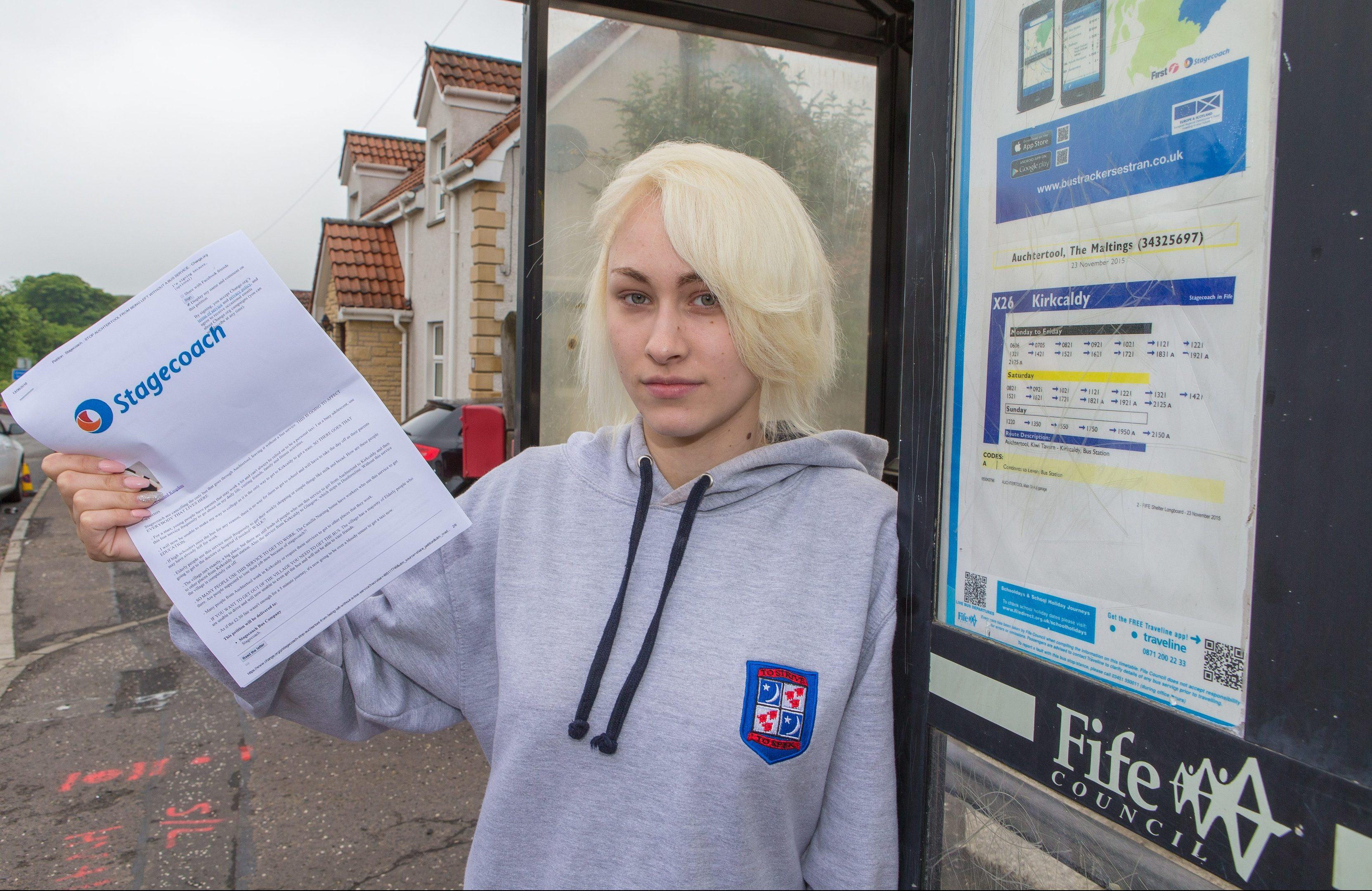 Abbi Gallagher with her petition to save the X26.