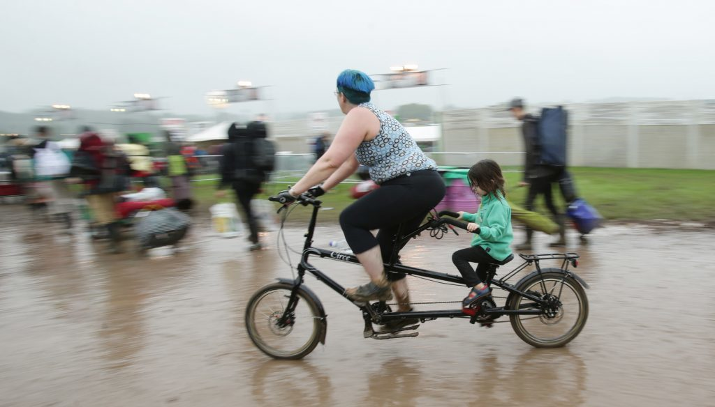 Festivalgoers arrive for the Glastonbury festival at the Worthy Farm site, Somerset, where heavy rain over a prolonged period has caused isolated flooding and muddy fields. PRESS ASSOCIATION Photo. Picture date: Wednesday June 22, 2016. See PA story SHOWBIZ Glastonbury. Photo credit should read:Yui Mok/PA Wire
