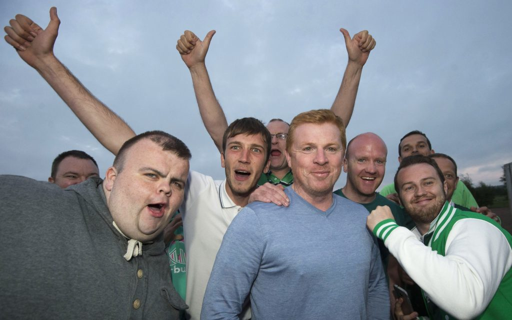 Neil Lennon, pictured with Hibs fans, has not always enjoyed good times.