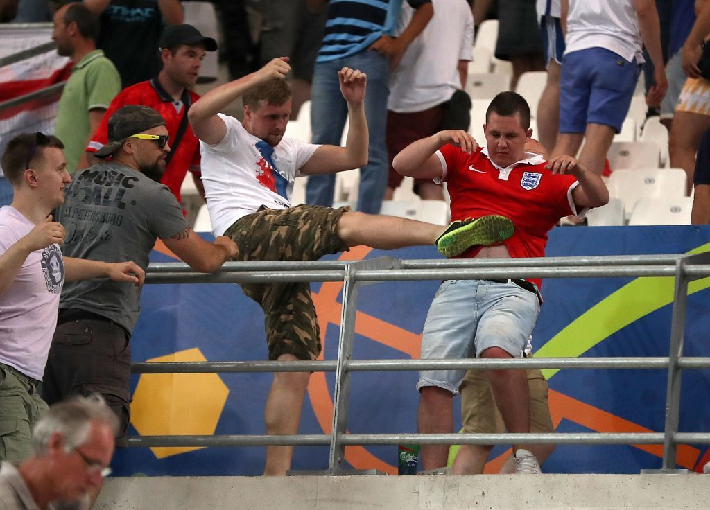 Russia have been handed a suspended disqualification from Euro 2016 over crowd disturbances at the game against England in Marseille.