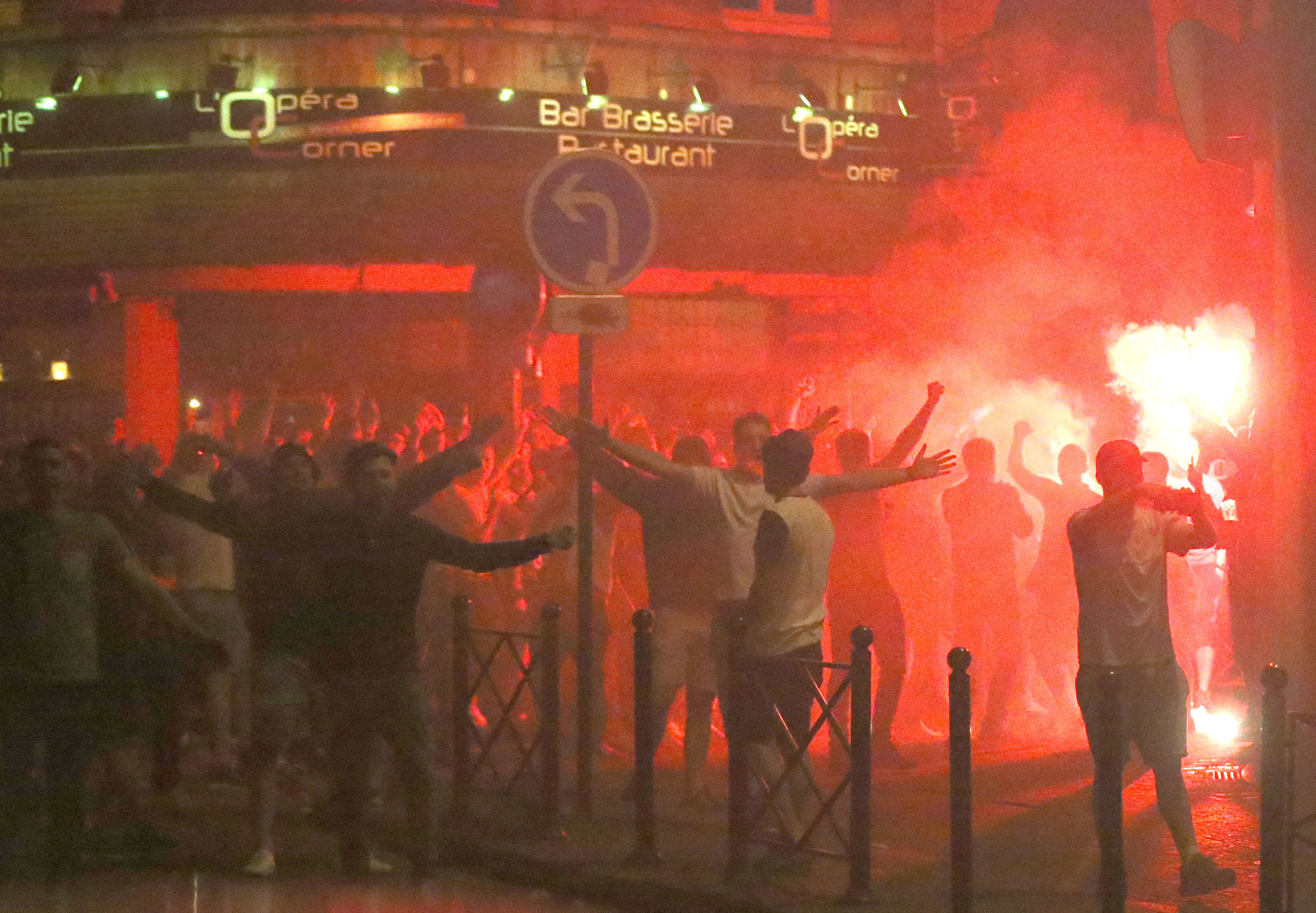 England fans lit by a burning flare in Lille city centre, France, as fresh clashes have taken place between England fans and Russian hooligans at Euro 2016.