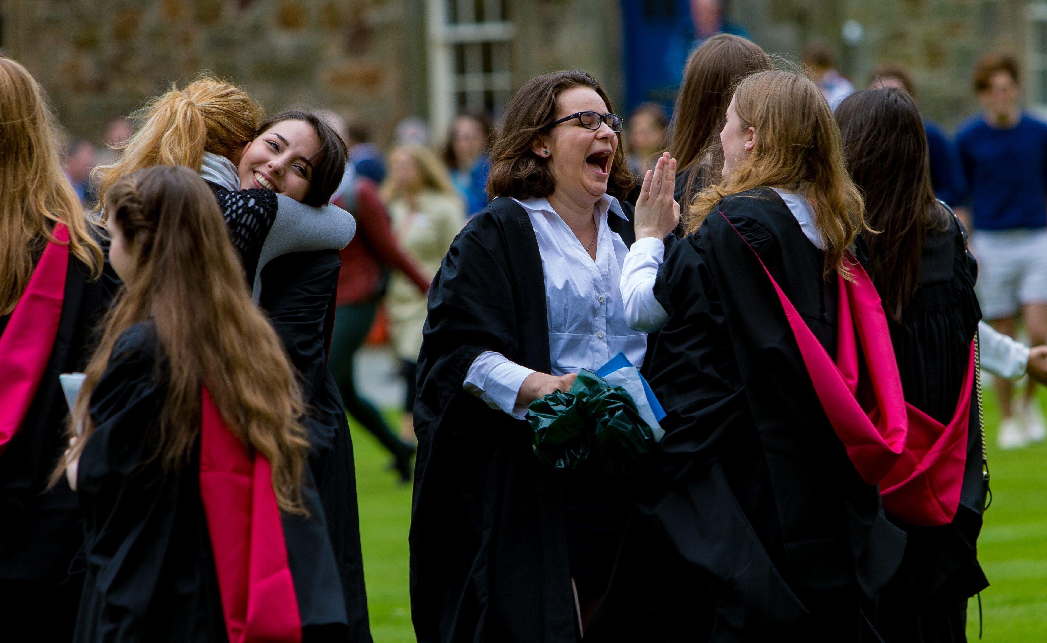 Students celebrate in St Salvators Quadrangle.