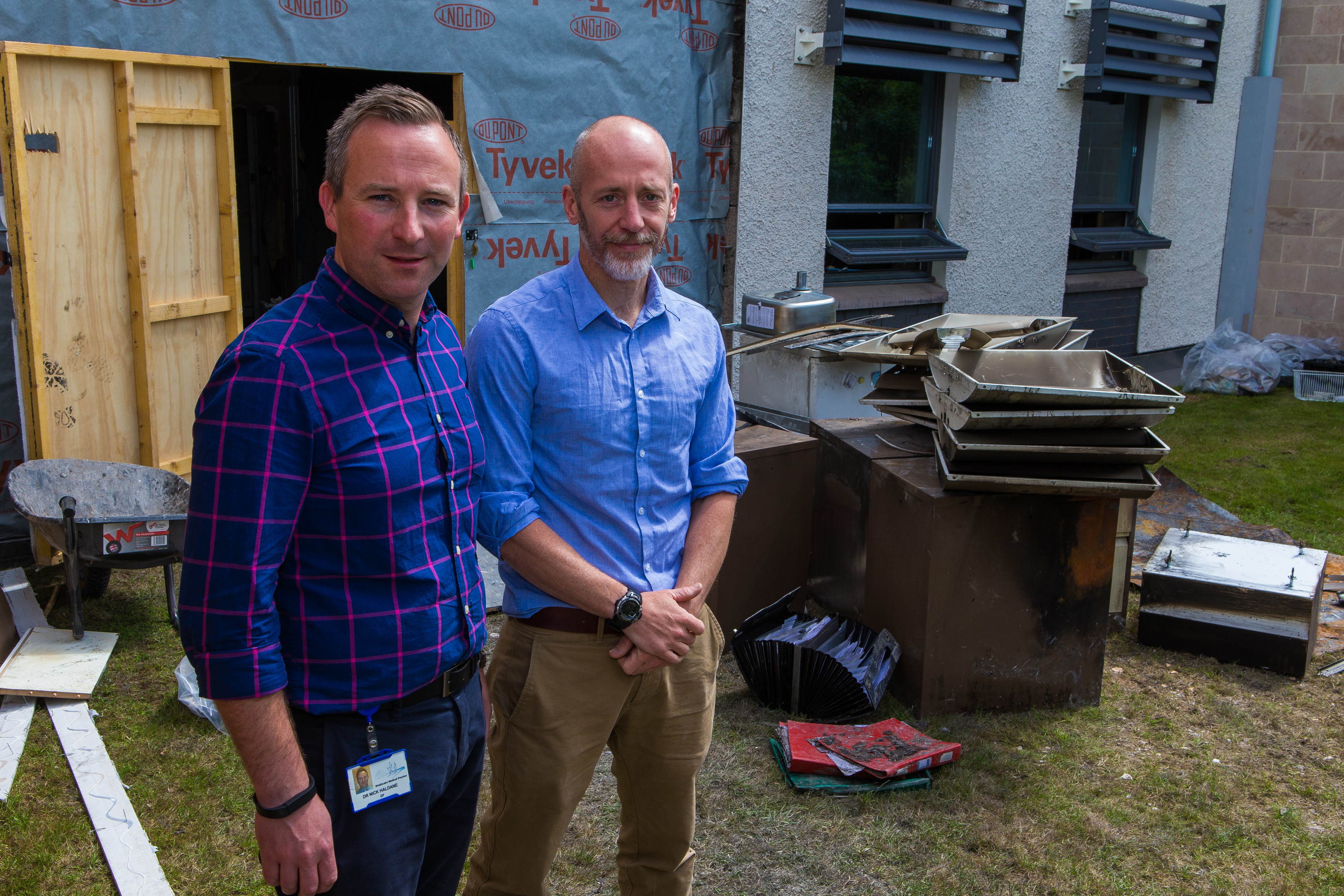 From left: Dr Nick Haldane and Dr Callum Duncan assessing the fire damage during the re-construction.
