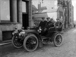 Four gentlemen golfers in a Car, St Andrews, 1904. By John Fairweather, held in Cowie Collection.