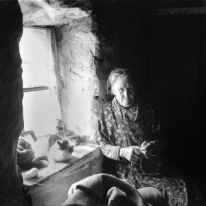 Woman in window, Harris, 1937. By Robert Moyes Adam.