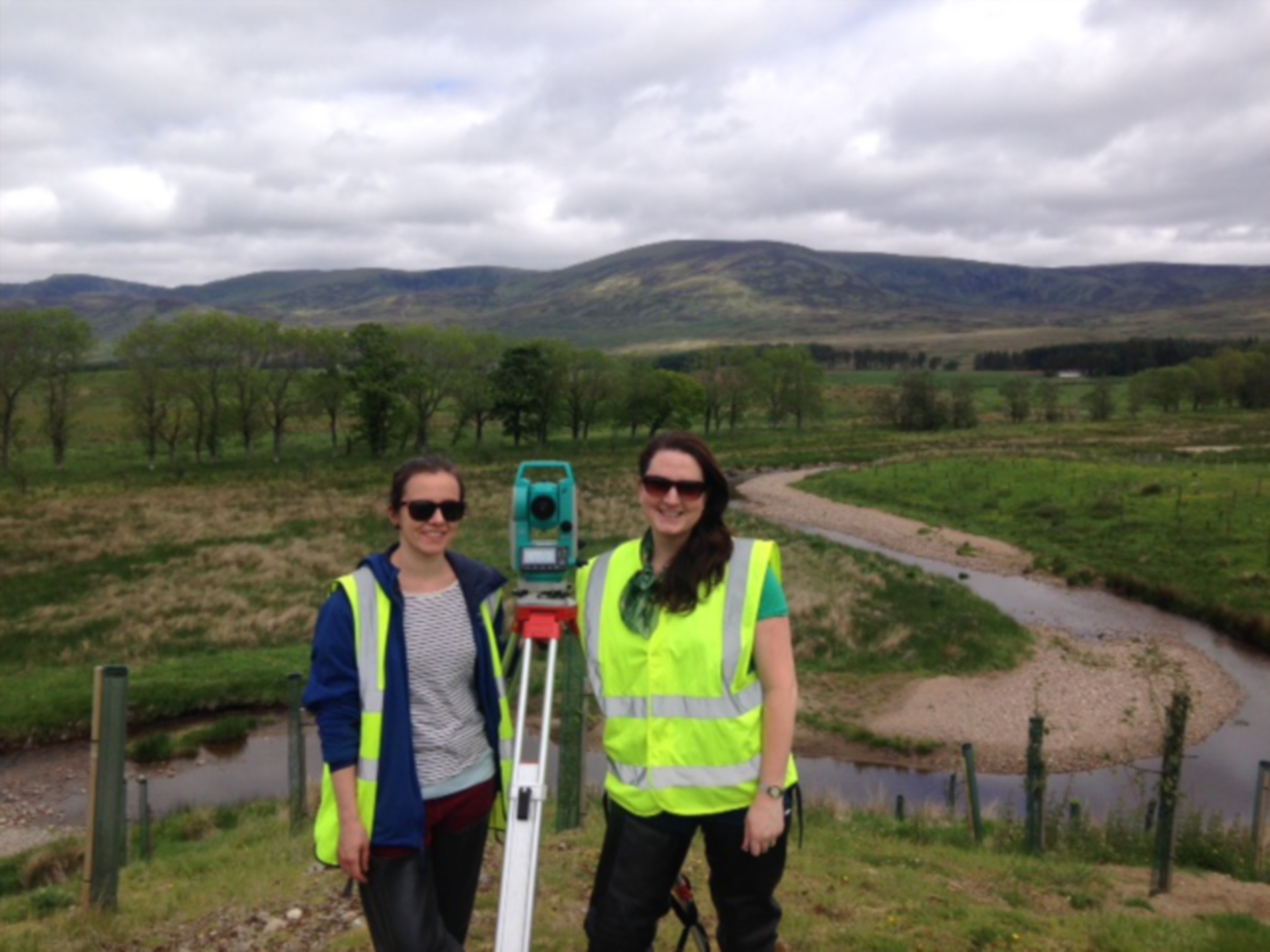 Student Mira Hanova and Dr Rebecca Wade using survey equipment to measure river erosion.