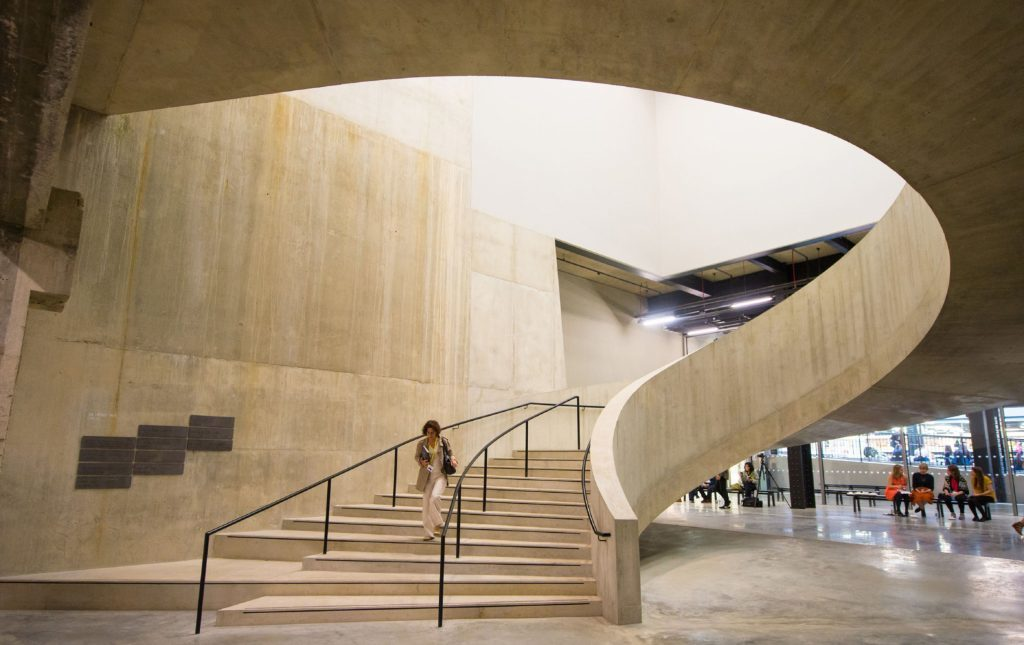 Visitor walking down a staircase in the new Switch House.
