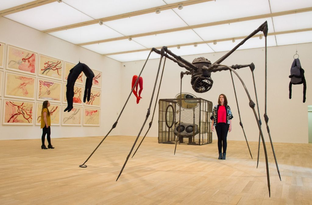 Photo of visitors viewing artworks including 'Spider' by Louise Bourgeois, one of the artworks on show in the new Switch House extension of the Tate Modern, in Southwark, London.