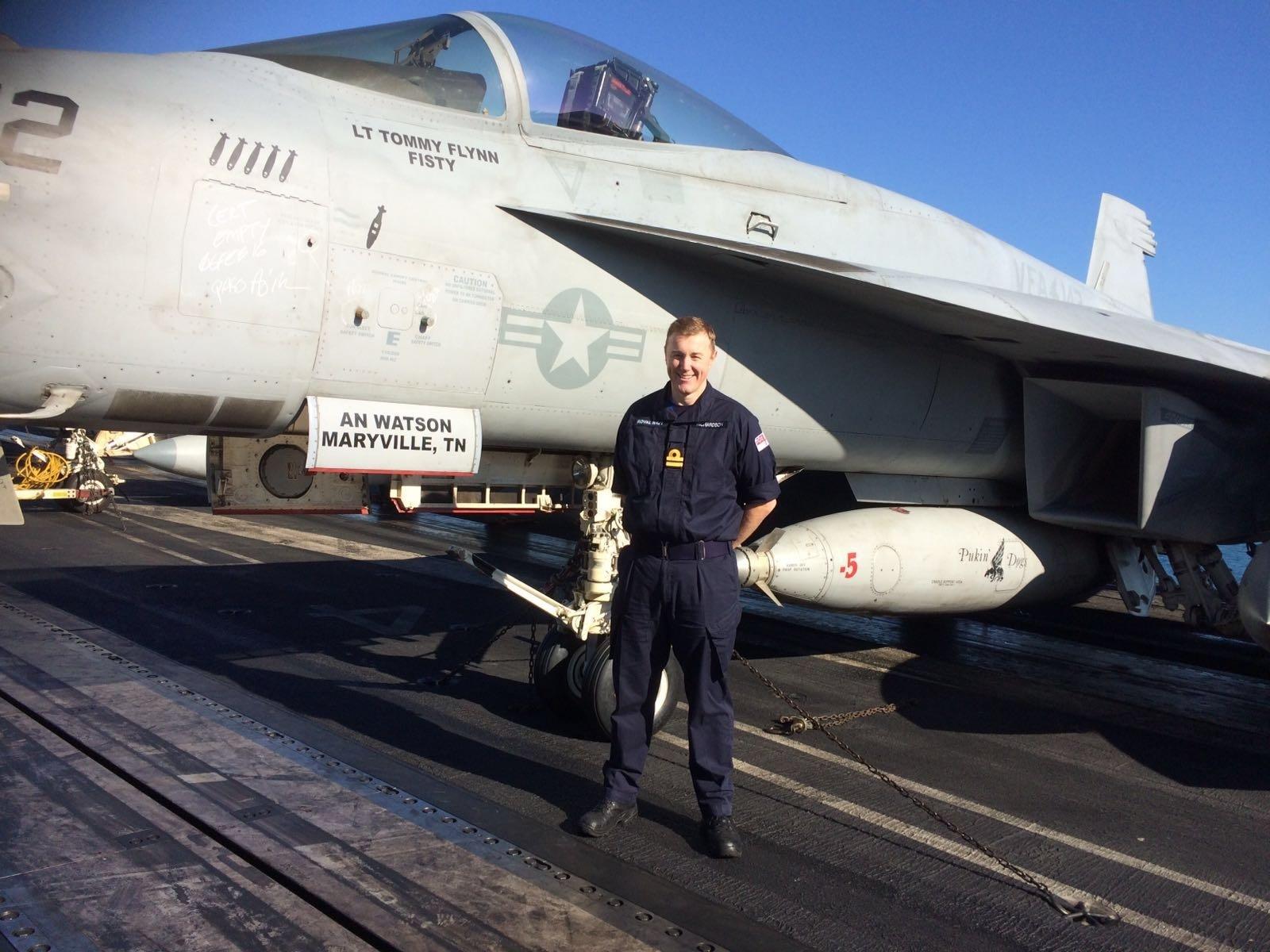 Sub-Lieutenant Barry Richardson on the flight deck of the USS Harry S Truman