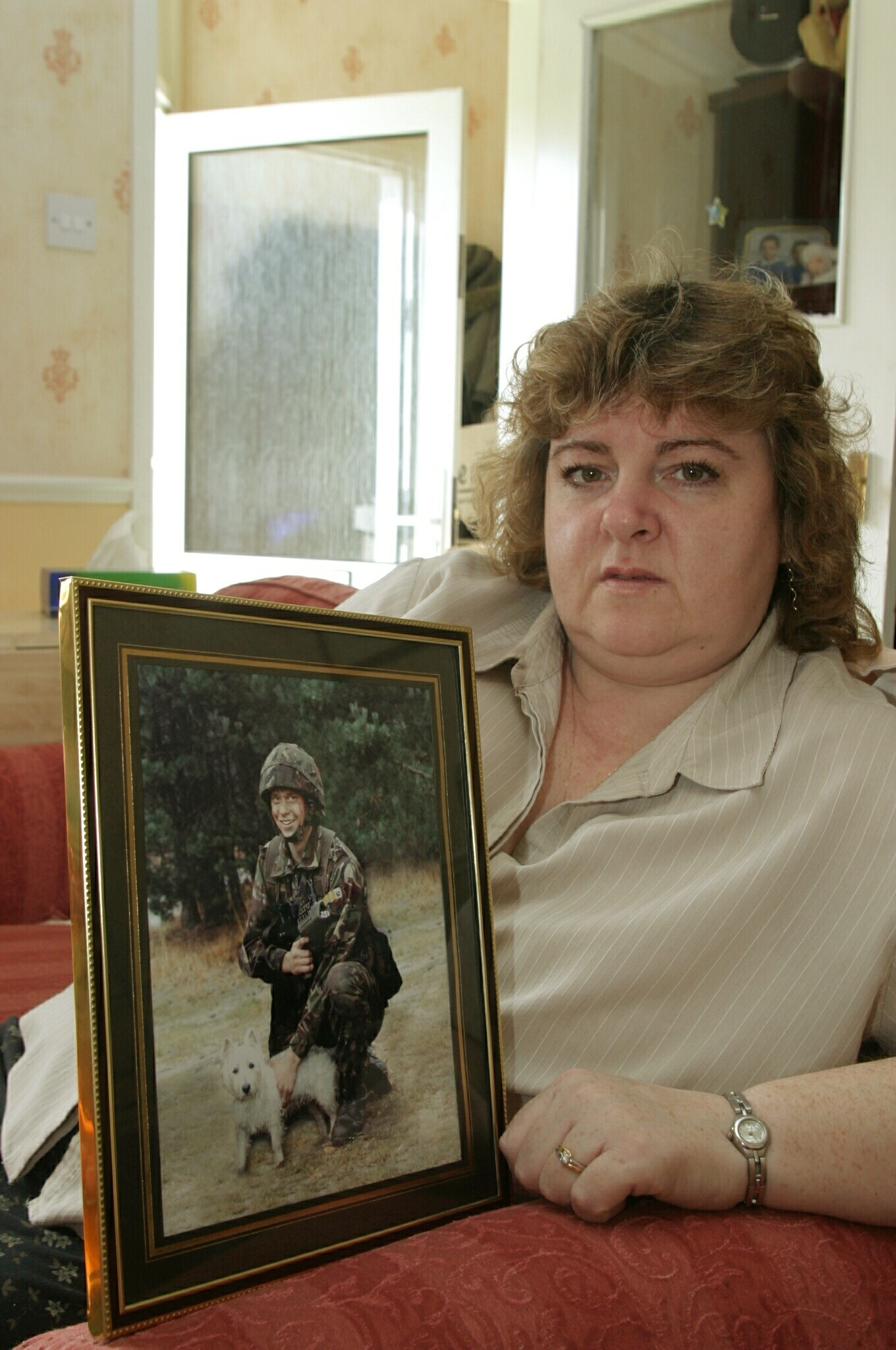 Pictured at home in Perth today, Friday 25th March 2005, is Yvonne Collinson with a picture of her son James.