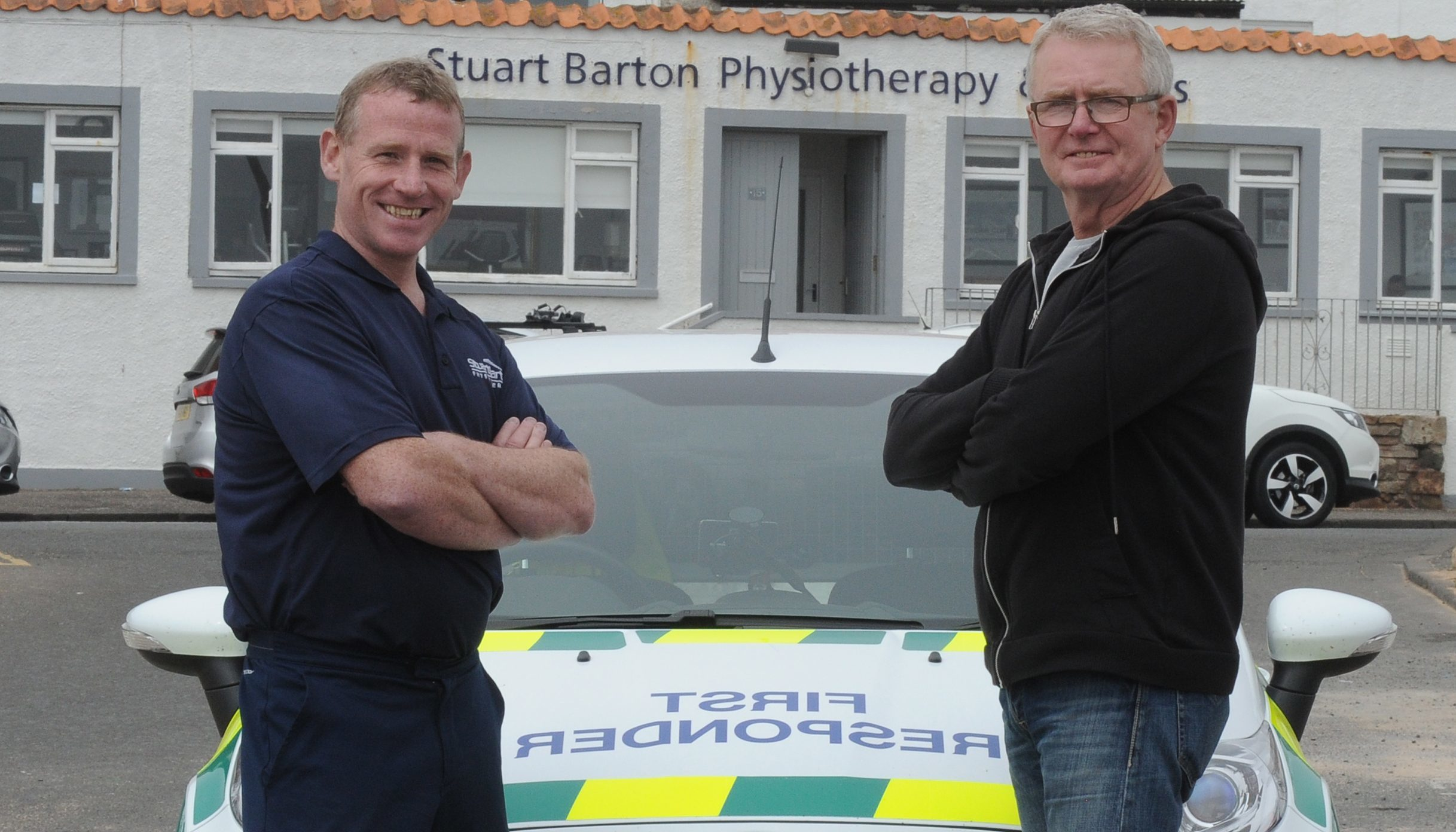 Stuart Barton (left) with Brian Clarke, whose life he saved
