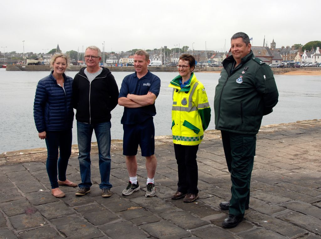 Pictured from left) Fiona Clarke Brians wife), Brian Clarke, Stuart Barton, Gillian Easson First Responder) and Ian Wilson paramedic St Andrews Station.