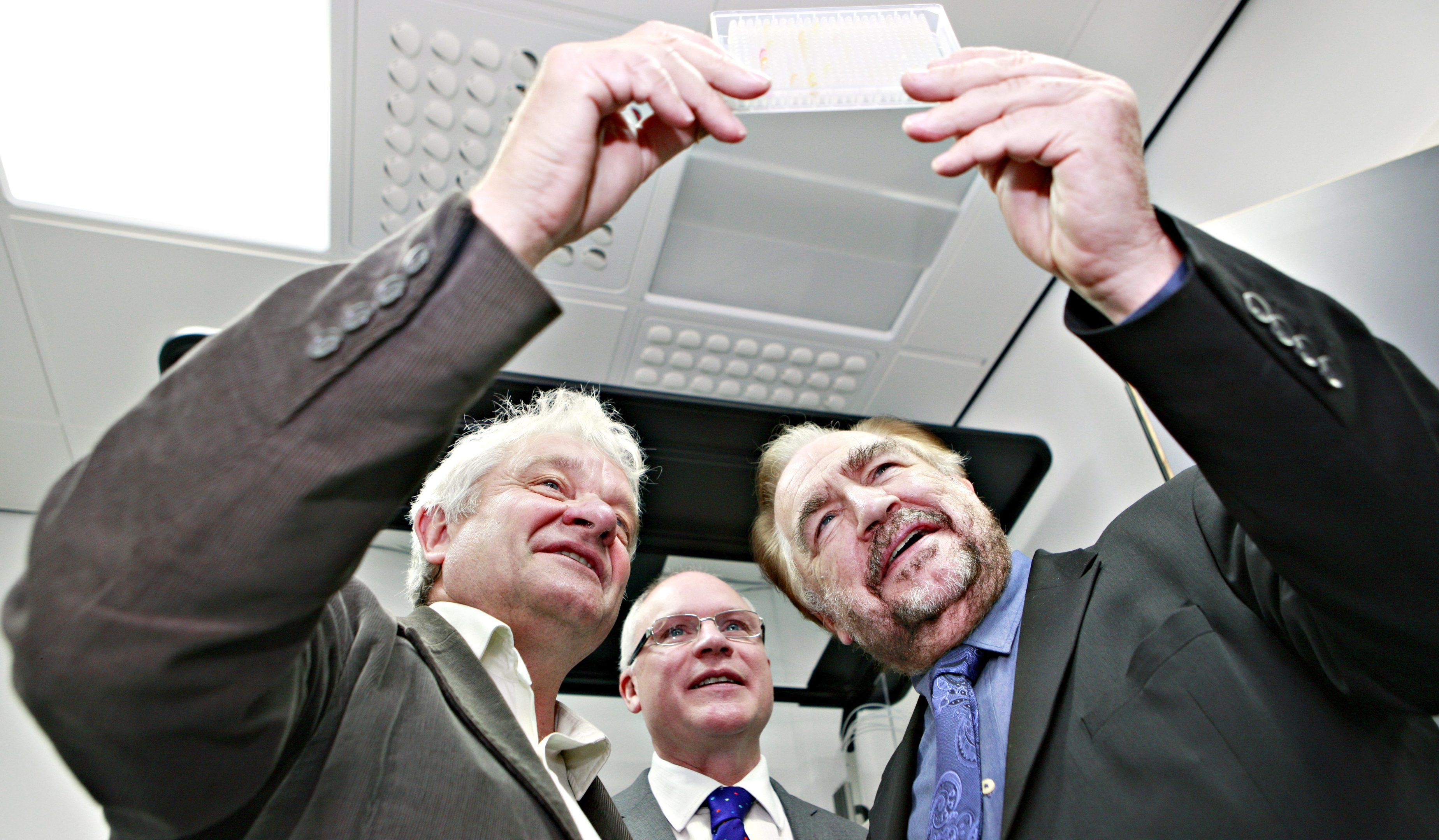 Sir Paul Nurse (left) on a visit to Dundee University in 2014, where he met Professor Mike Ferguson and then rector Brian Cox.