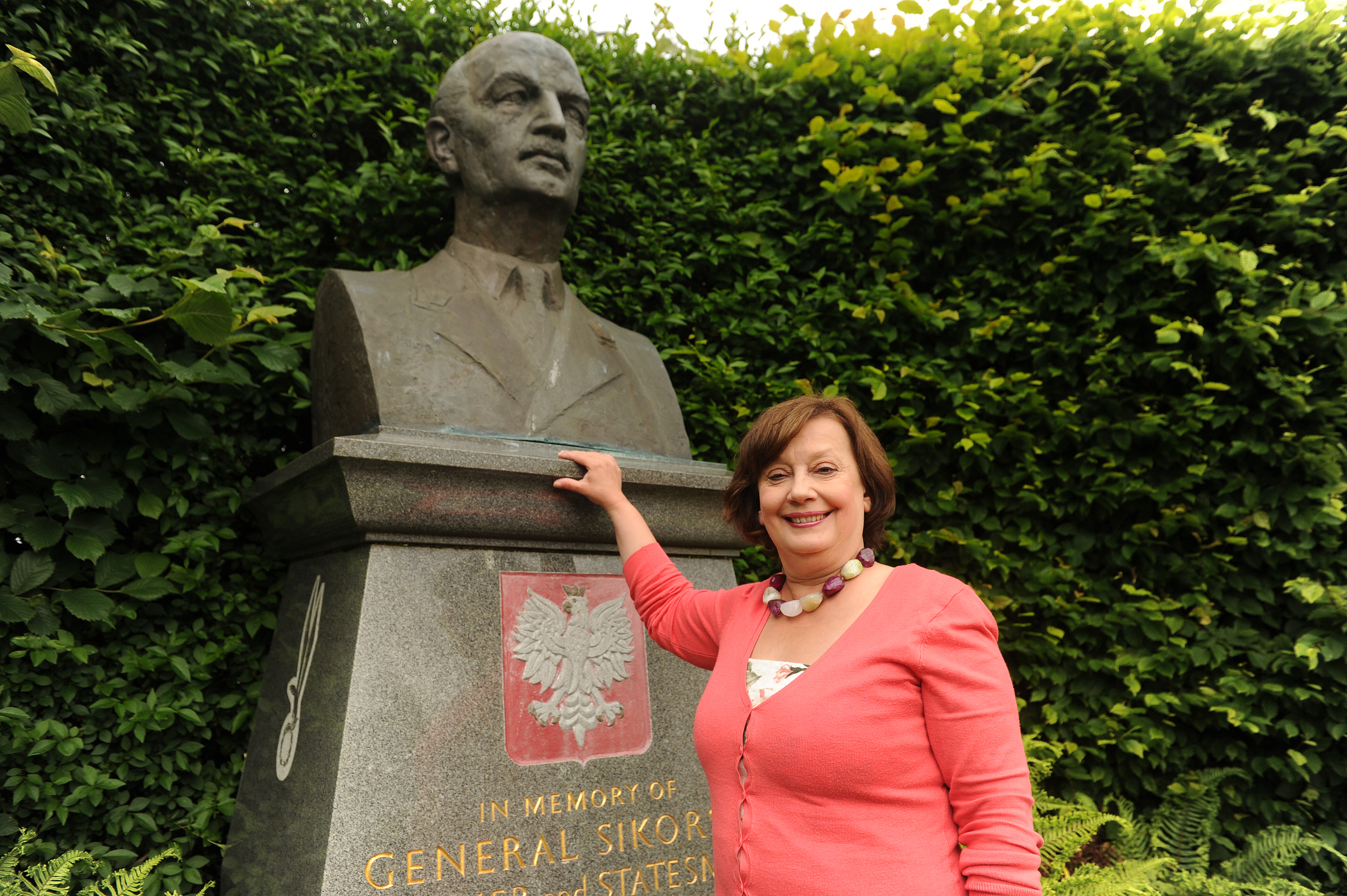 Polish woman Violeta Llendo next to the statue of WWII Polish General Sikorski at Kinburn Park, St Andrews