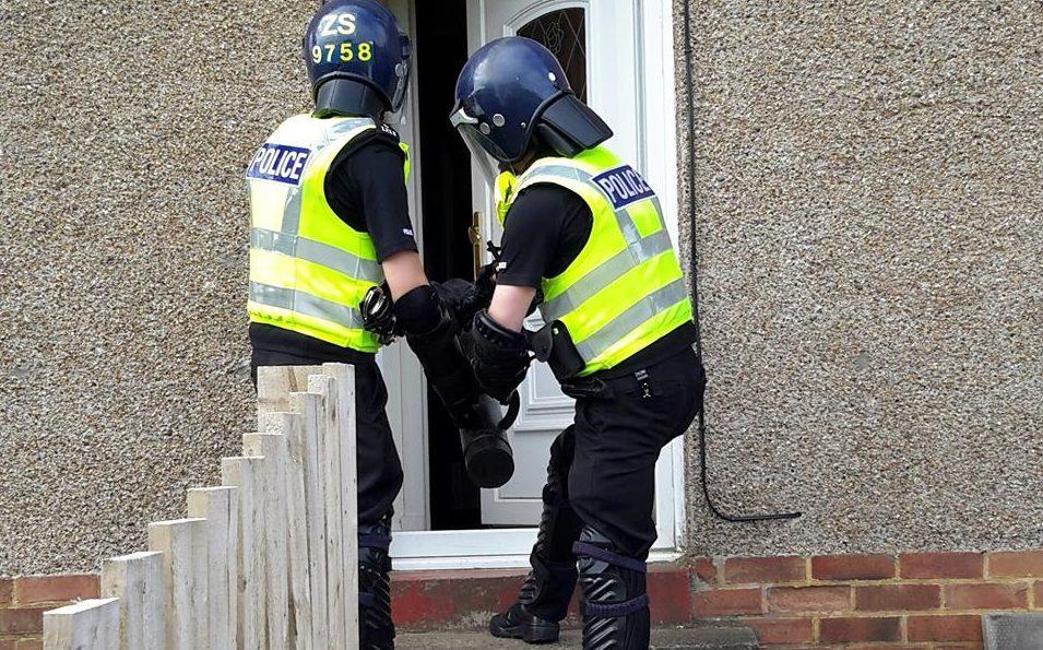 A police drug raid.