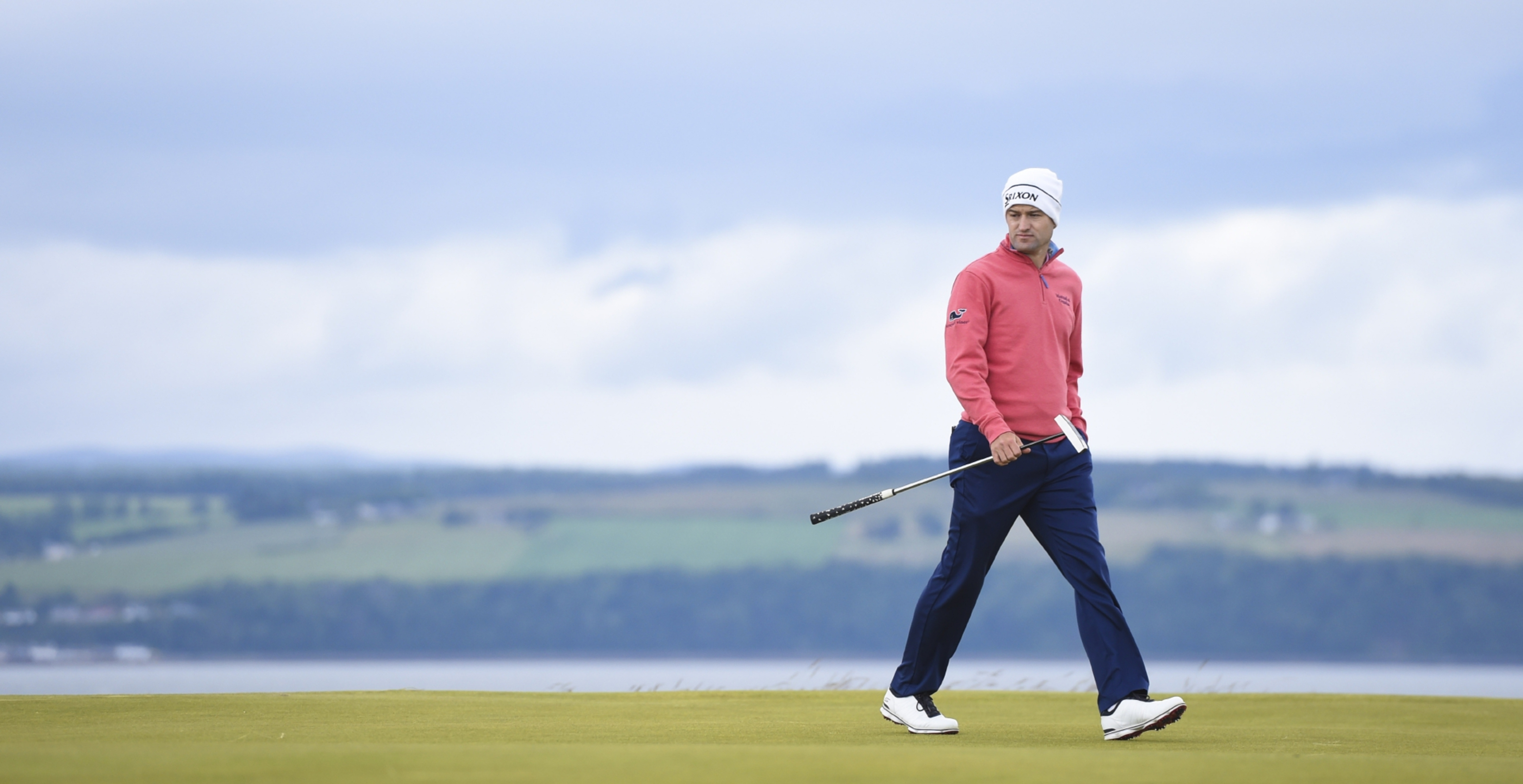 Russell Knox prowls his ball on an exposed green at Castle Stuart.