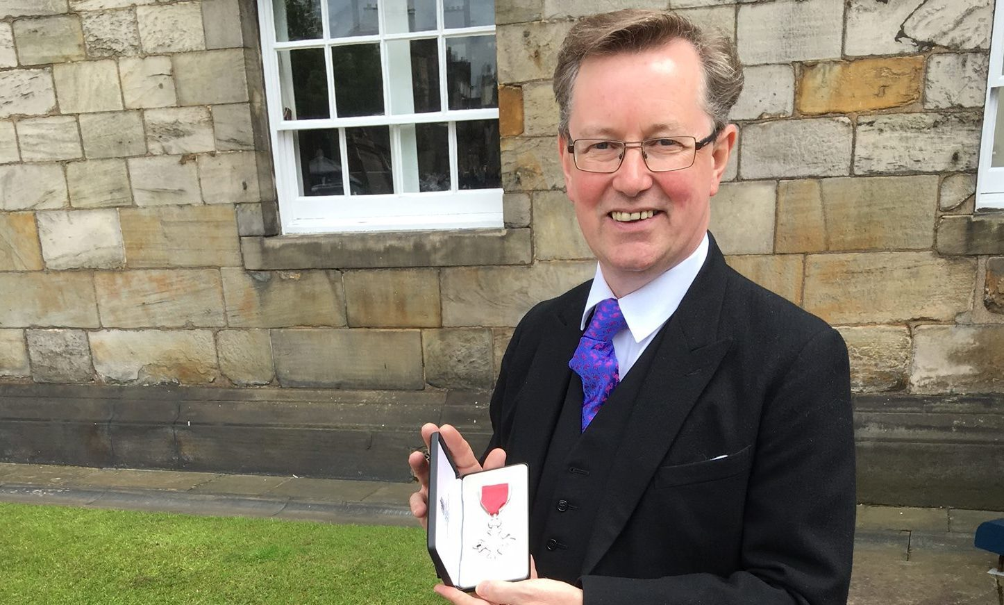 Alexander Stewart with his MBE.