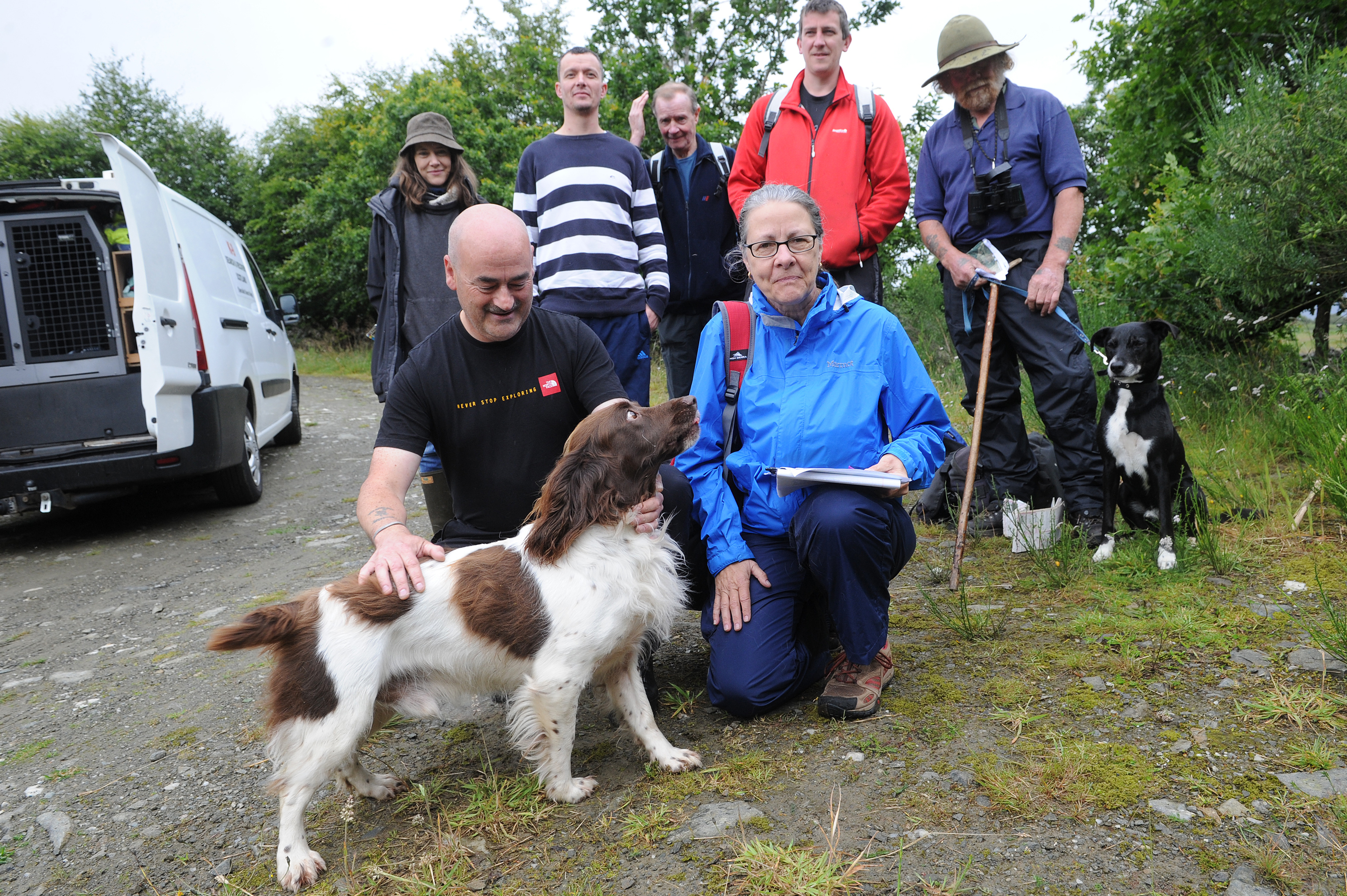 15.08.15 - pictured at the start of the Loch Hoil Trail, Aberfeldy (Crieff Road end) are some of the community who turned out to search for missing American tourist Susan McLean - back l to r - Brooke Baker, Steven Ferguson, Alistair Cameron, Gary Forsyth and Mitch Bain with 'Bing' - front - Iain Marshall (K9 Search and Recovery) with 'Barra' who is the only submerged cadaver search dog in Scotland and Susan's friend Lorna VanderZanden who is co-ordinating the continuing searches