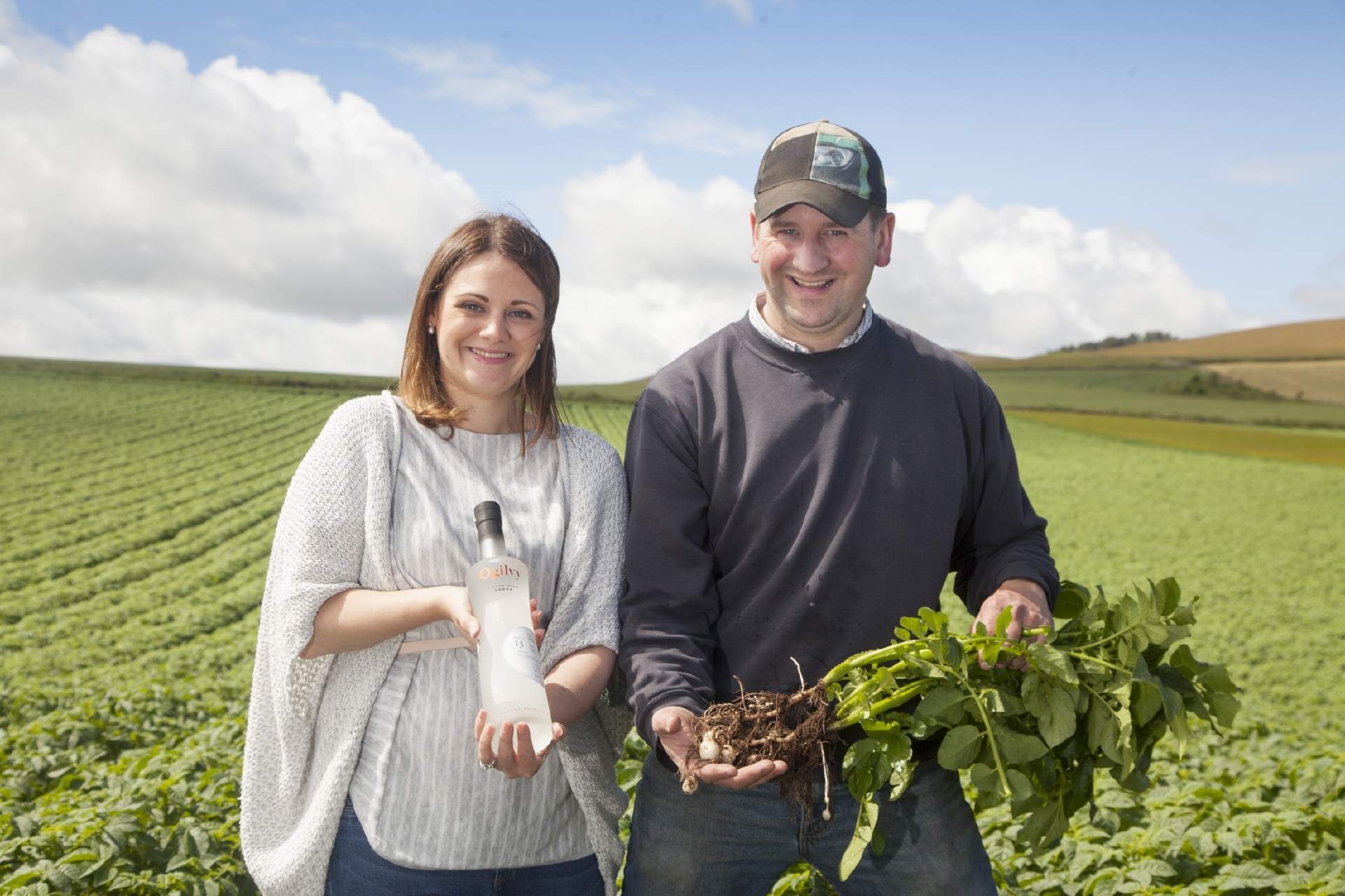 Ogilvy Spirits Ltd.  Hatton of Ogilvy Farm  Glamis, Angus...production of Ogilvy Vodka from Maris Piper potatoes.. Caroline Bruce-Jarron holding the finished product with Graeme Jarron holding some young plants from this years crop on the way...Pic Paul Reid