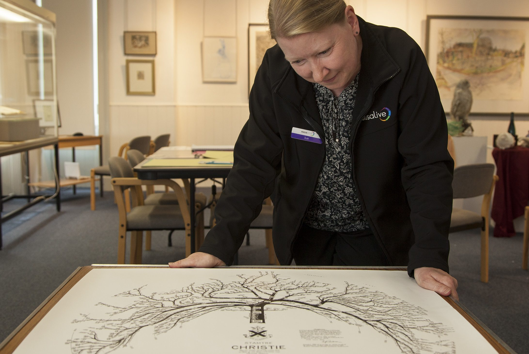 Museum assistant Sue Hampson with the Christies family tree