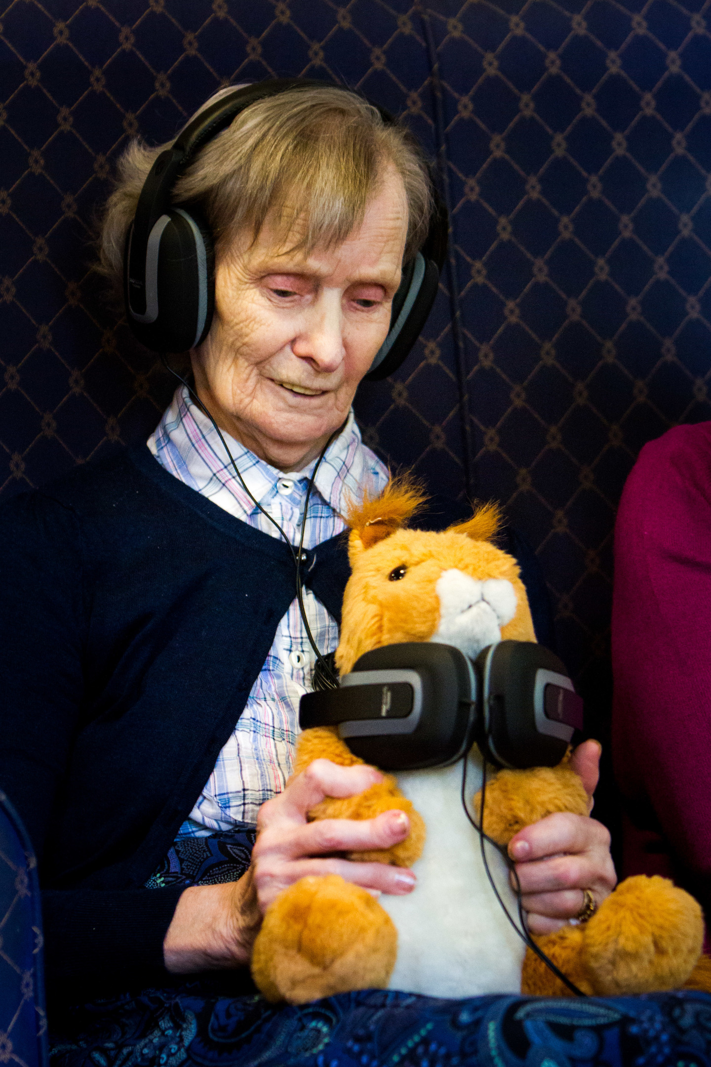 Louisebrae resident Cecilia and teddy enjoy the music.