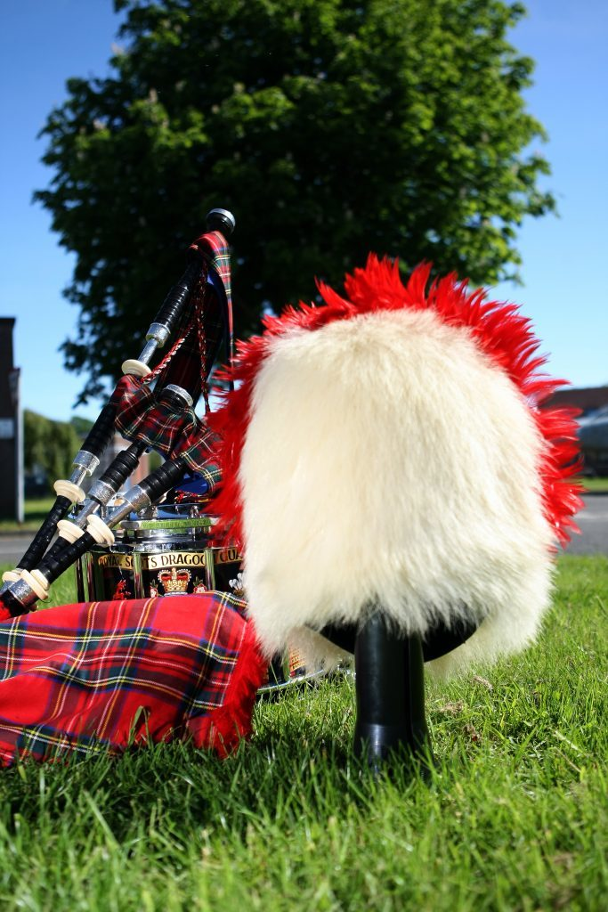 Pipes, drums and a polar bear, bear skin hat