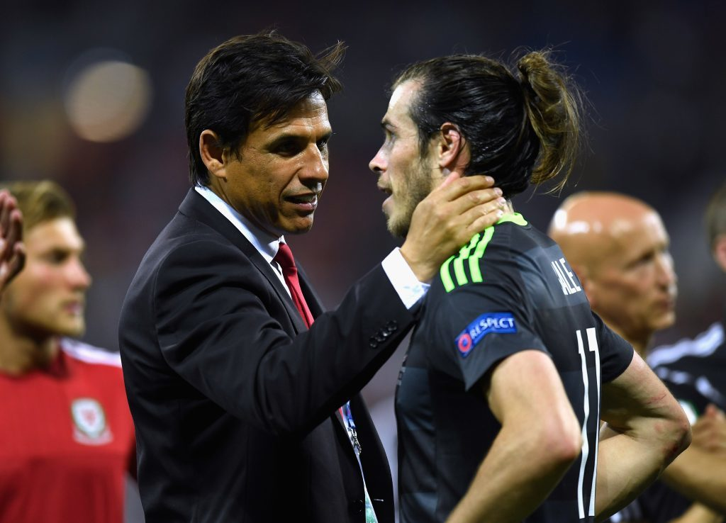 LYON, FRANCE - JULY 06:  Chris Coleman manager of Wales consoles Gareth Bale of Wales after defeat in the UEFA EURO 2016 semi final match between Portugal and Wales at Stade des Lumieres on July 6, 2016 in Lyon, France.  (Photo by Mike Hewitt/Getty Images)
