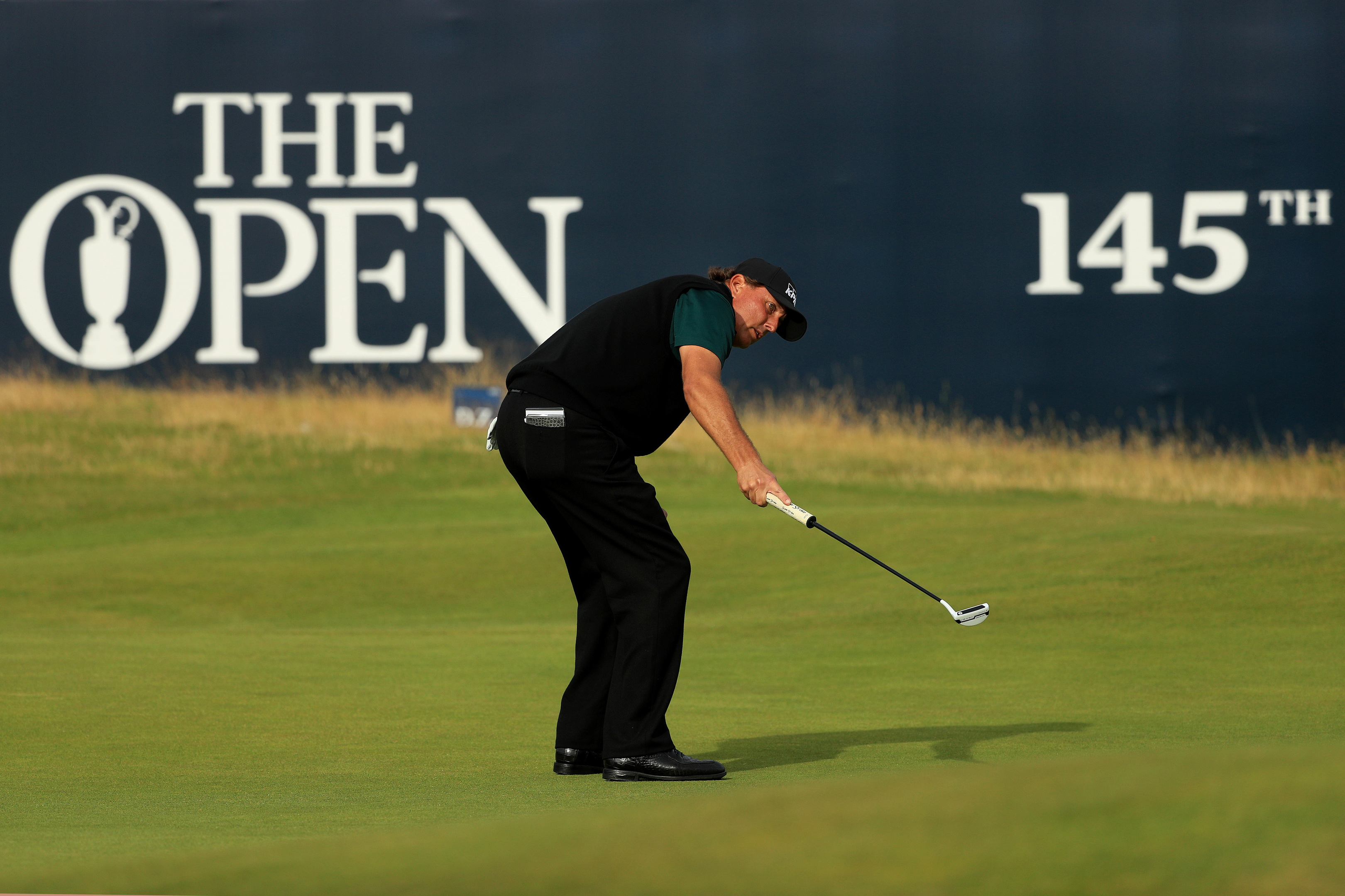 Phil Mickelson watches in disbelief as his putt for an historic 62 lips out on the 18th at Royal Troon.