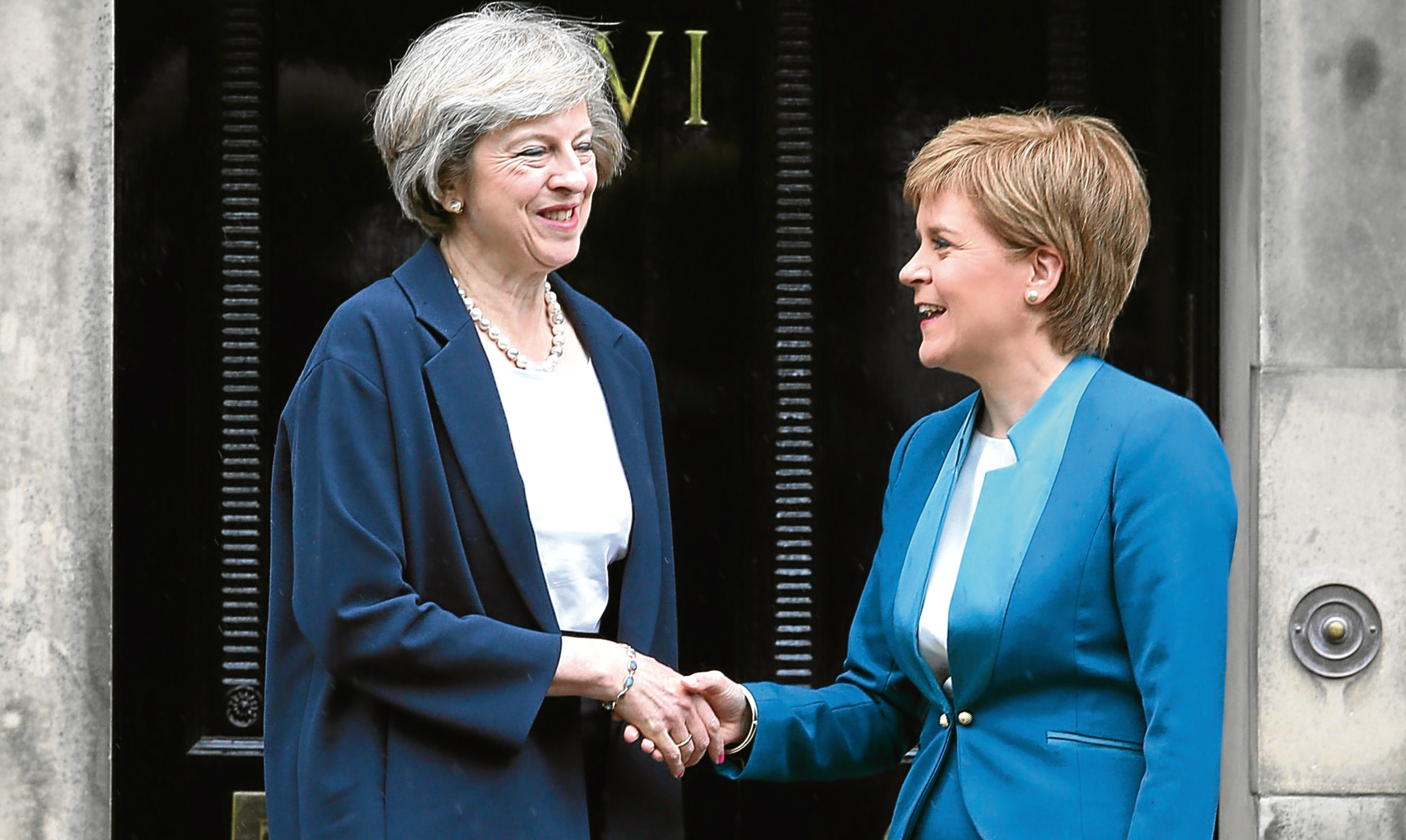 Theresa May greeted by Nicola Sturgeon outside Bute House in July.