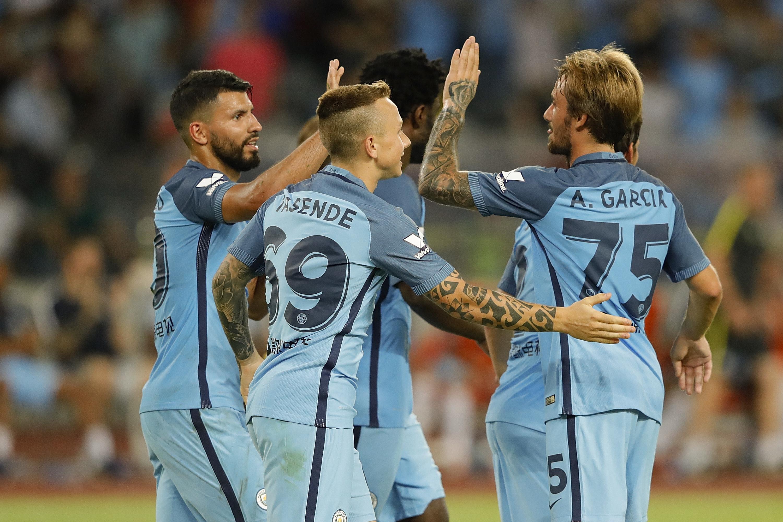 Sergio Aguero (left) celebrates with his City team mates after he scores against Borussia Dortmund.