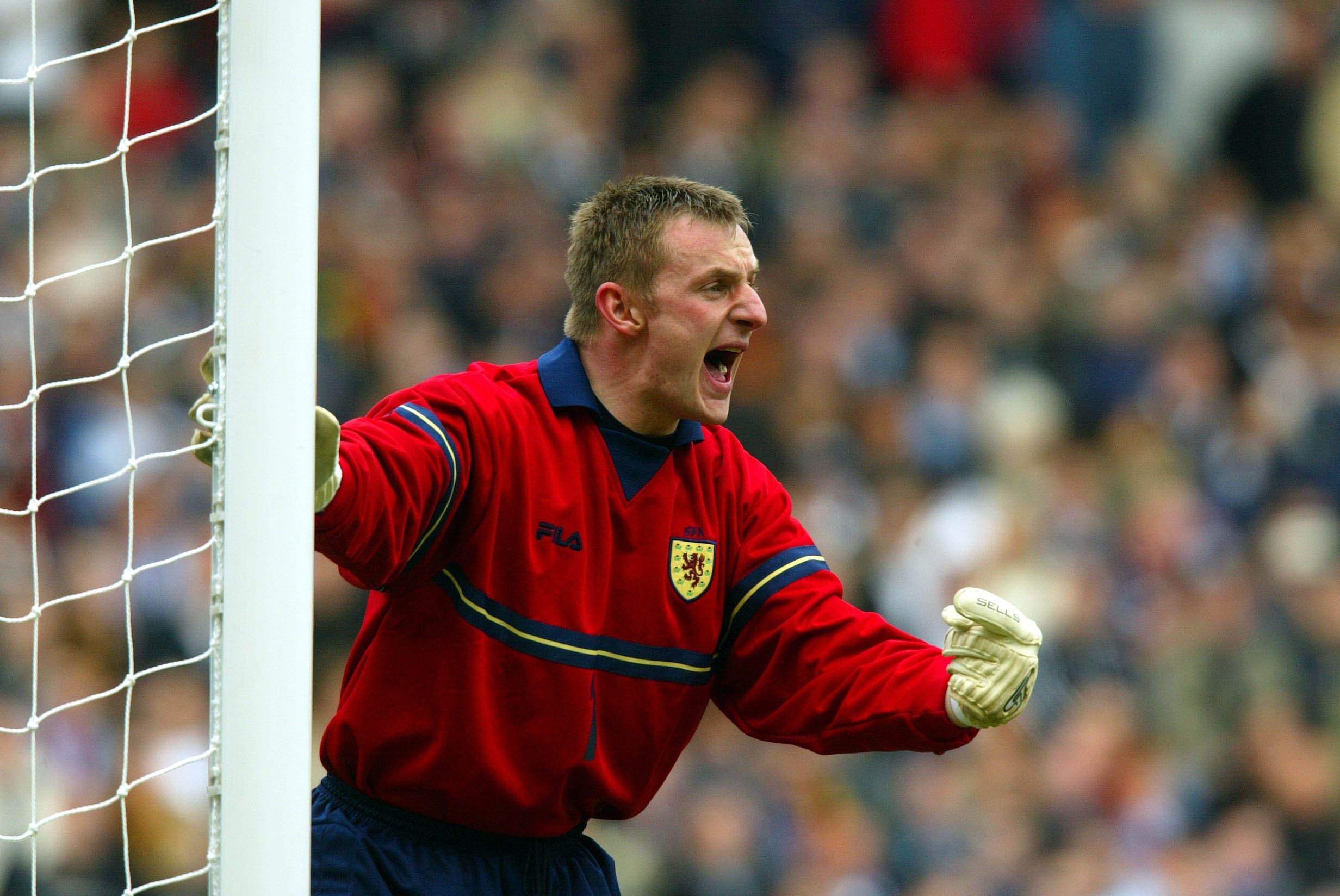 Rab Douglas in action for Scotland.